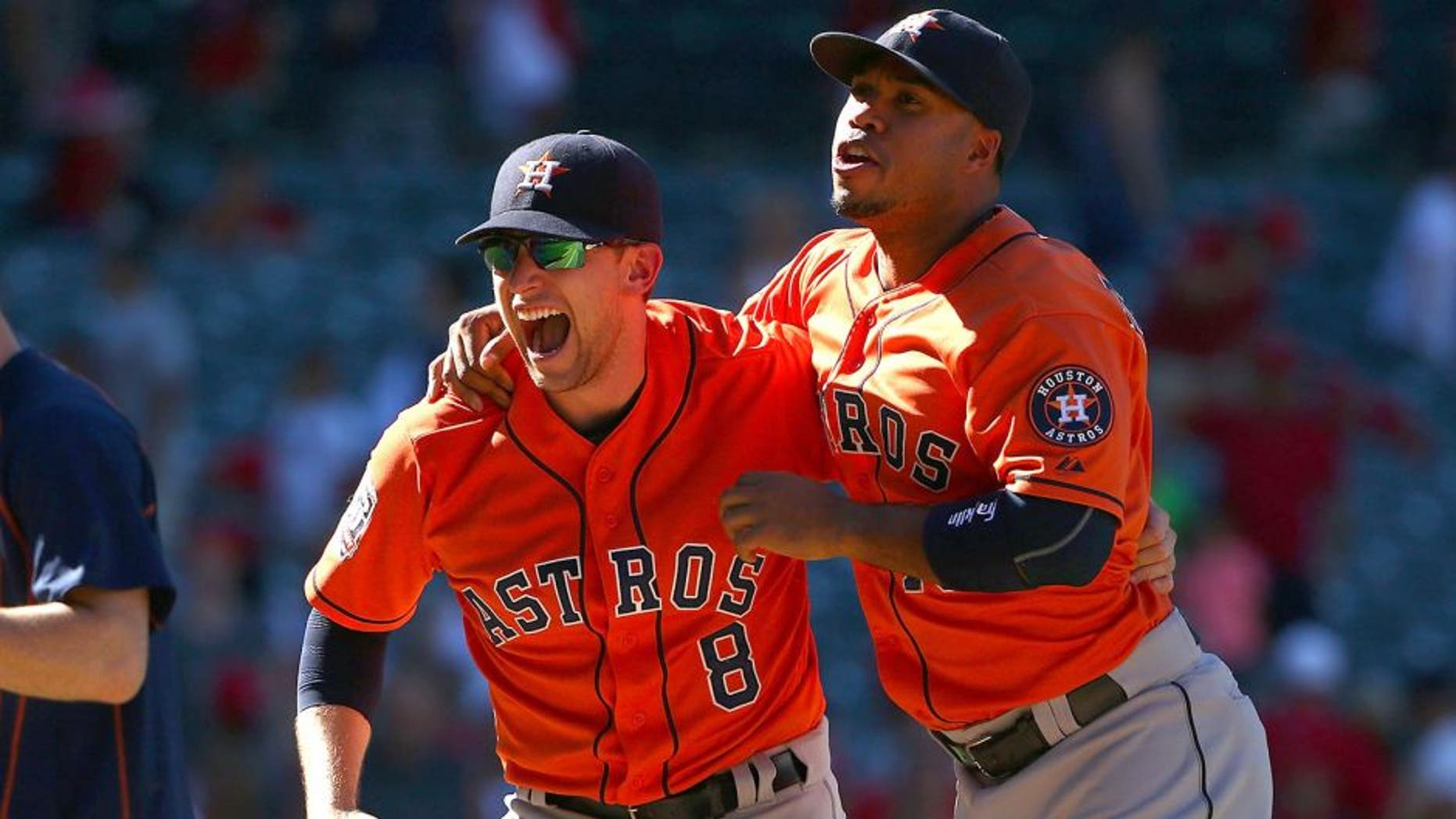 ANAHEIM, CA - SEPTEMBER 13: Jed Lowrie #8 and Luis Valbuena #18 of the Houston Astros celebrate after their 5-3 come-from-behind win against the Los Angeles Angels of Anaheim in the ninth inning in their MLB game at Angel Stadium of Anaheim on September 13, 2015 in Anaheim, California. (Photo by Victor Decolongon/Getty Images)