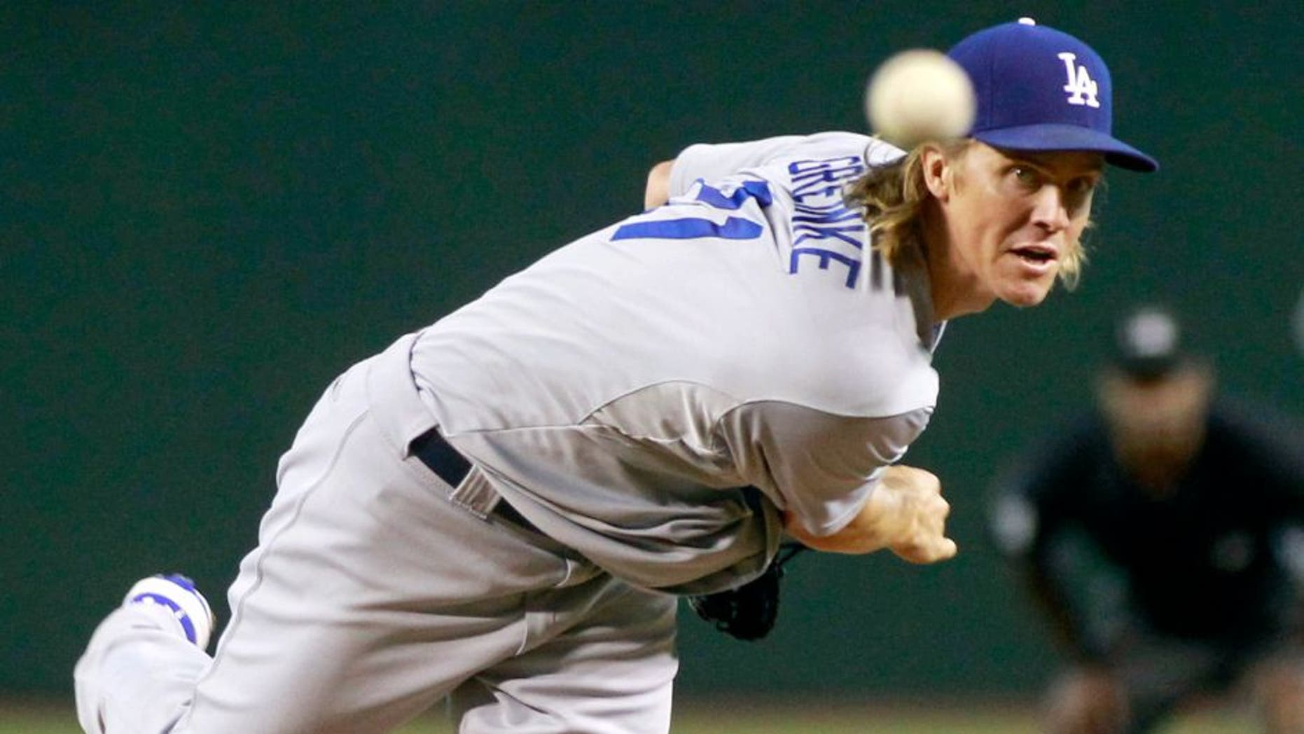 Los Angeles Dodgers starting pitcher Zach Greinke throws against the Arizona Diamondbacks during the first inning of a baseball game, Sunday, Sept. 13, 2015, in Phoenix. (AP Photo/Ralph Freso)