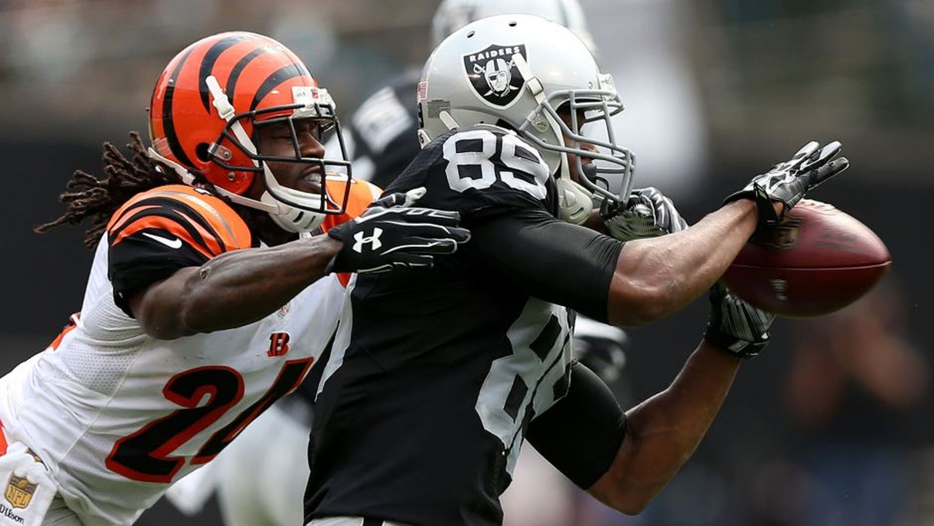 OAKLAND, CA - SEPTEMBER 13: Adam Jones #24 of the Cincinnati Bengals defends a pass to Amari Cooper #89 of the Oakland Raiders during the first half of their NFL game at O.co Coliseum on September 13, 2015 in Oakland, California. (Photo by Ezra Shaw/Getty Images)
