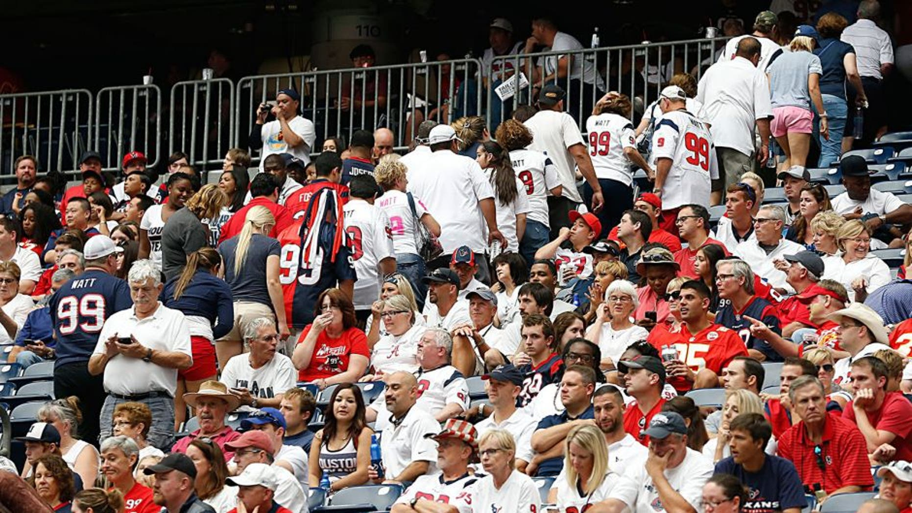 HOUSTON, TX - SEPTEMBER 13: Houston Texans fans leave early while the Texans play the Kansas City Chiefs in the second half in the second quarter in a NFL game on September 13, 2015 at NRG Stadium in Houston, Texas. (Photo by Bob Levey/Getty Images)