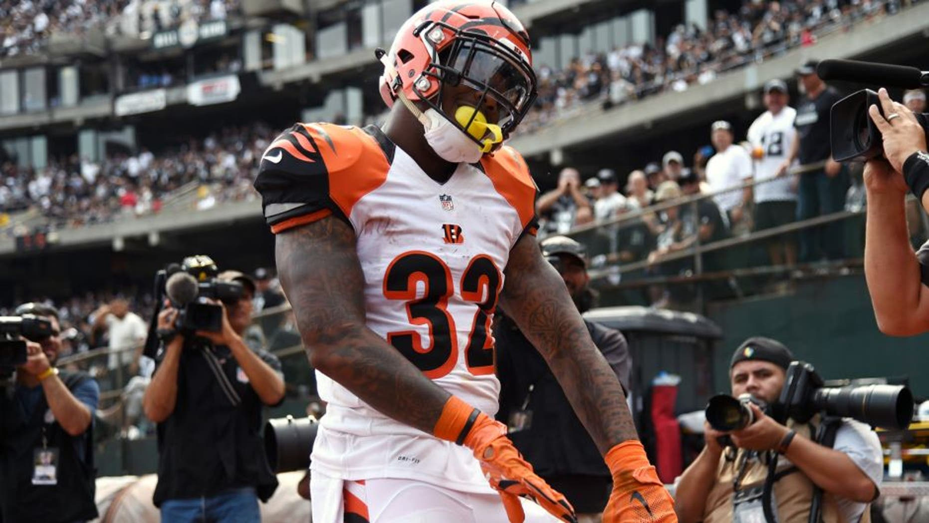 OAKLAND, CA - SEPTEMBER 13: Jeremy Hill #32 of the Cincinnati Bengals celebrates his touchdown during the first half of their NFL game at O.co Coliseum on September 13, 2015 in Oakland, California. (Photo by Thearon W. Henderson/Getty Images)