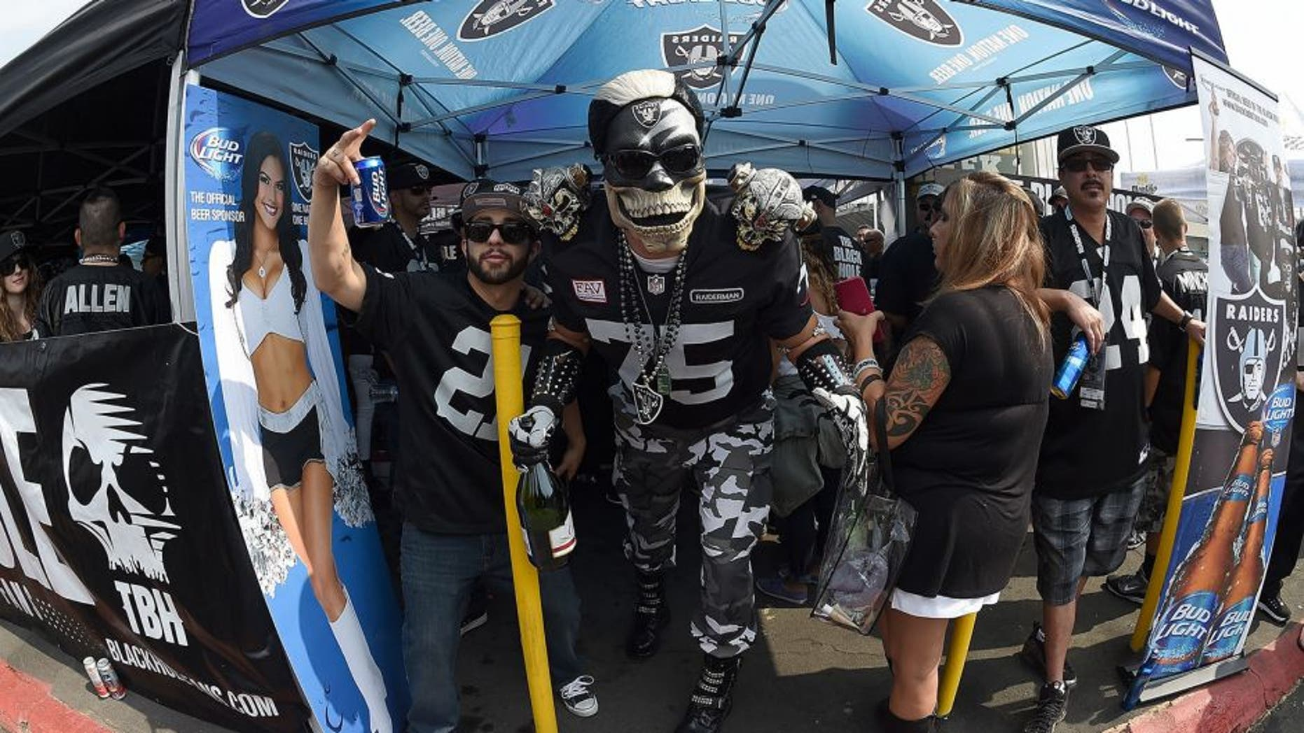 OAKLAND, CA - SEPTEMBER 13: Fans tailgating in the parking lot prior to the Cincinnati Bengals v Oakland Raiders NFL football game at the O.co Coliseum on September 13, 2015 in Oakland, California. (Photo by Thearon W. Henderson/Getty Images)