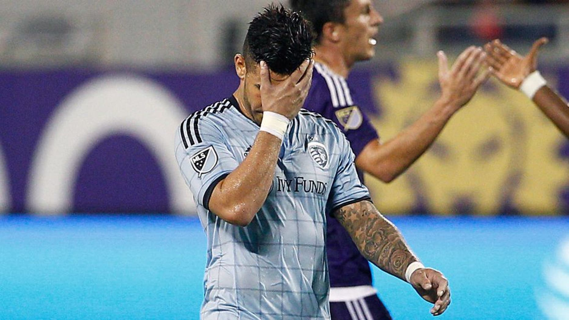 Sep 13, 2015; Orlando, FL, USA; Sporting KC forward Dom Dwyer (14) covers his face after being issued a red card during the second half against the Orlando City FC at Orlando Citrus Bowl Stadium. Mandatory Credit: Reinhold Matay-USA TODAY Sports