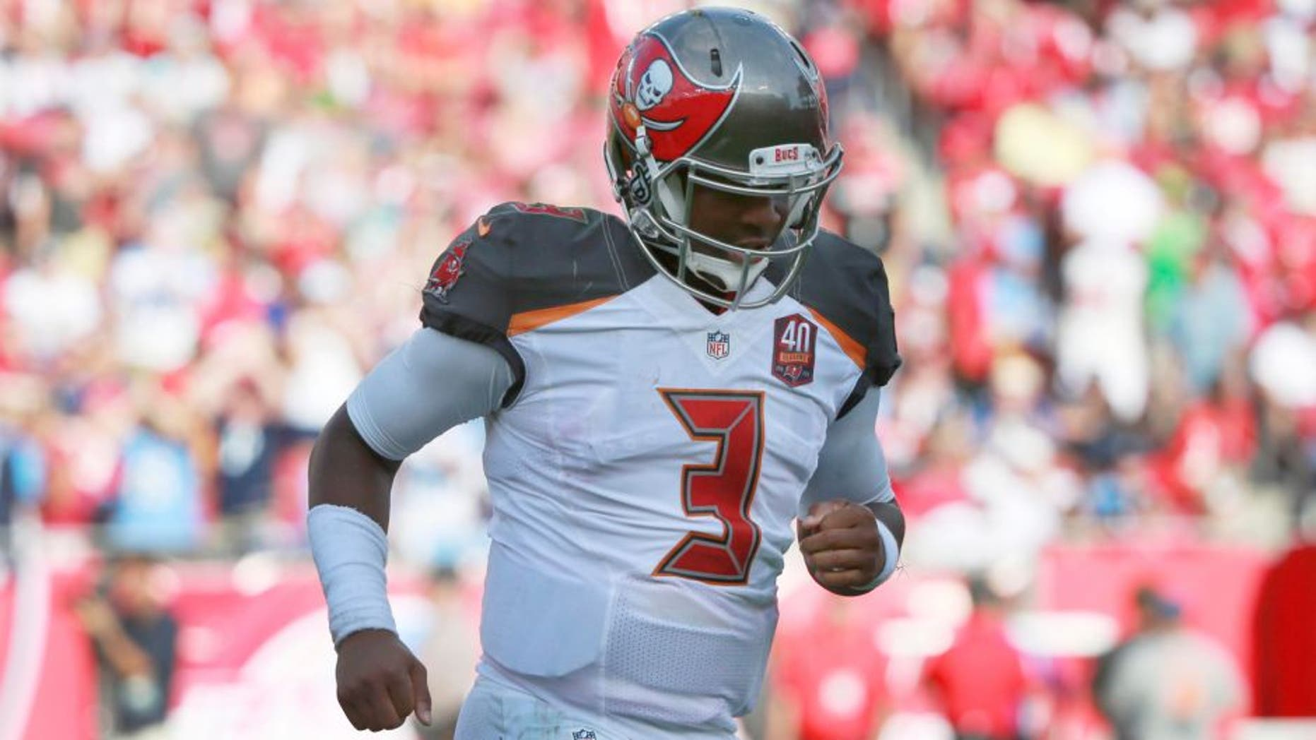 Sep 13, 2015; Tampa, FL, USA; Tampa Bay Buccaneers quarterback Jameis Winston (3) runs off the field at the end of the first half against the Tennessee Titans at Raymond James Stadium. Mandatory Credit: Kim Klement-USA TODAY Sports