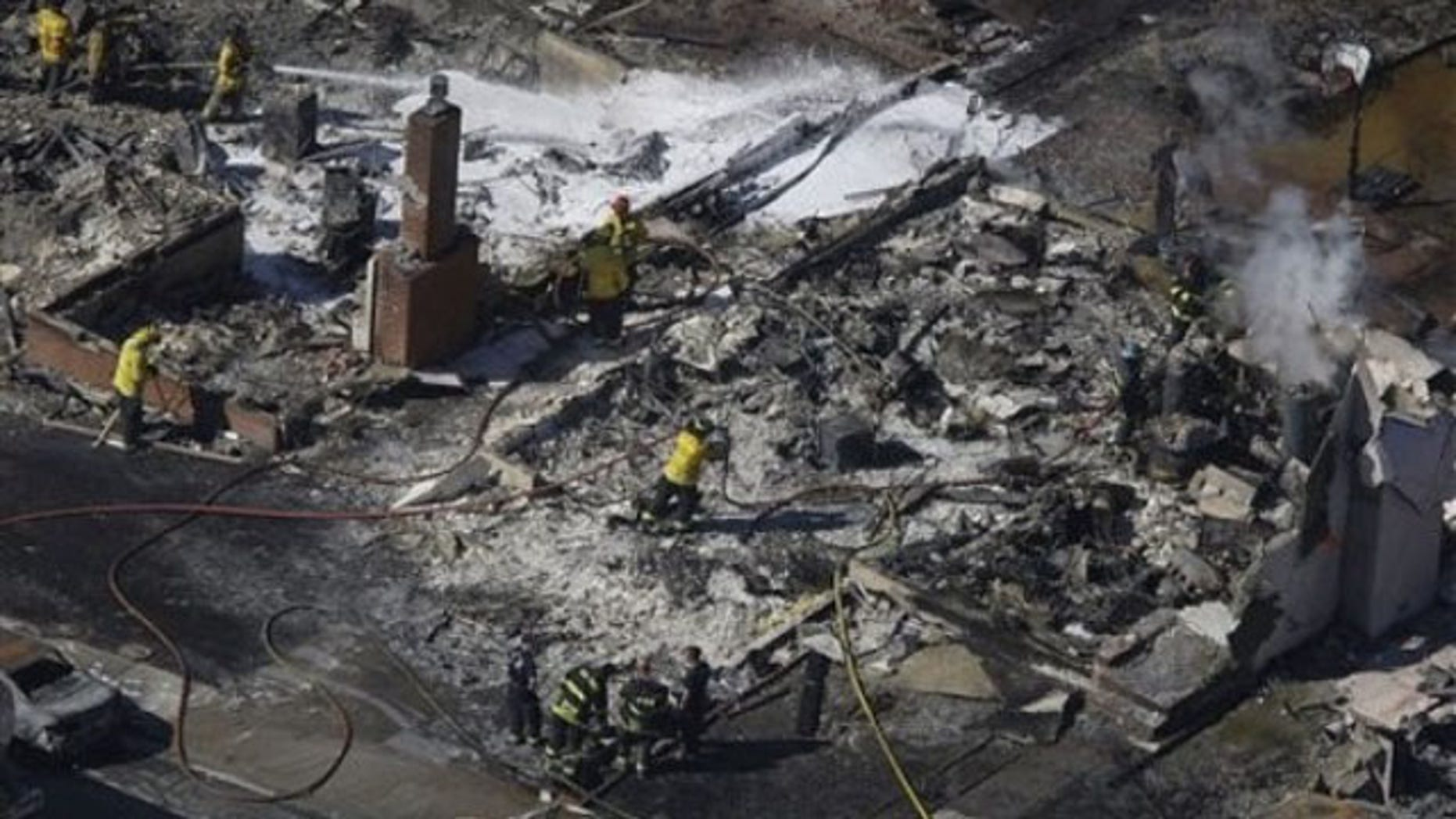 Sept. 10: Firemen work on the remains of a home damaged by a massive fire in a mostly residential neighborhood in San Bruno, Calif. (AP).