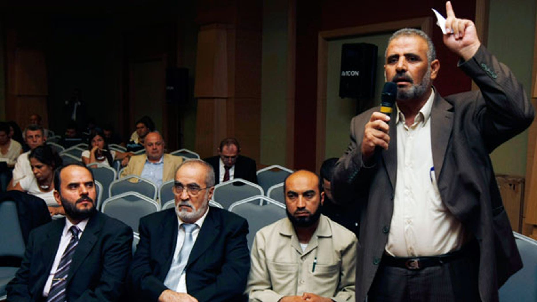 Sept. 15: Jamal Al Wadi from the Syrian city of Daraa speaks as Syrian opposition members listen after they announced a Syrian National Council in their bid to present a united front against President Bashar Assad's regime, in Istanbul, Turkey.