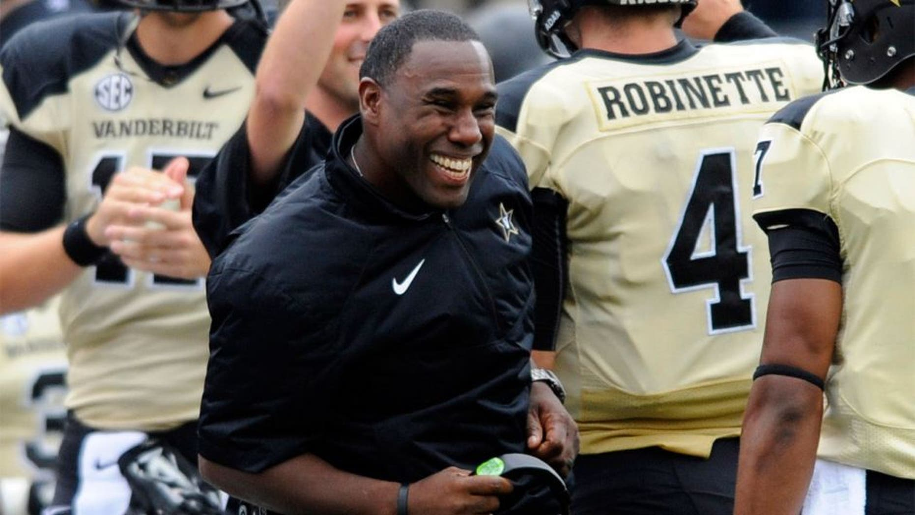 Sep 13, 2014; Nashville, TN, USA; Vanderbilt Commodores head coach Derek Mason celebrates after a touchdown during the first half against the Massachusetts Minutemen at Vanderbilt Stadium. Mandatory Credit: Christopher Hanewinckel-USA TODAY Sports