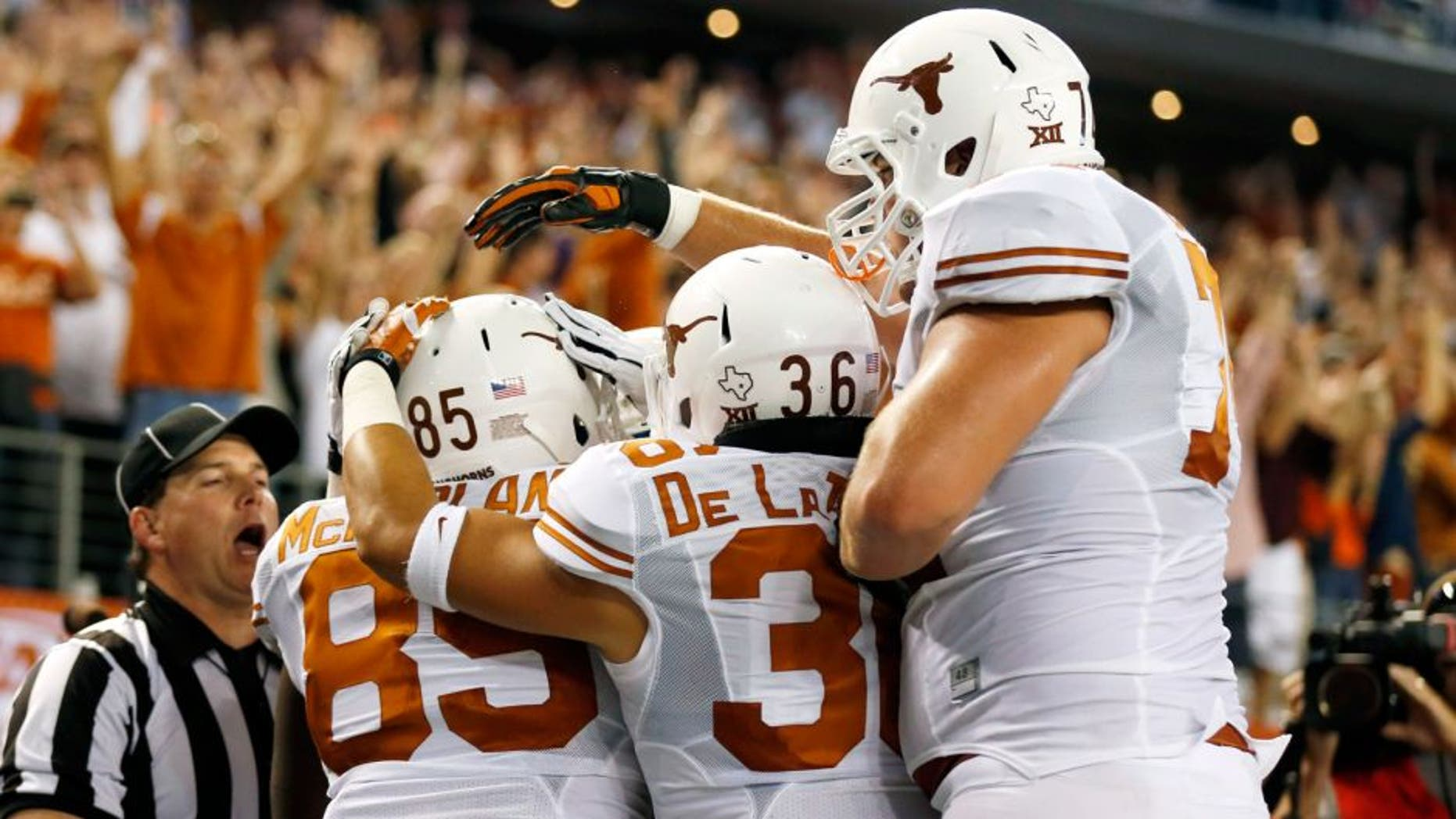 Sep 13, 2014; Arlington, TX, USA; Texas Longhorns tight end M.J. McFarland (85) celebrates making a touchdown with fullback Alex De La Torre (36) against the UCLA Bruins during the second quarter at AT&T Stadium. Mandatory Credit: Matthew Emmons-USA TODAY Sports