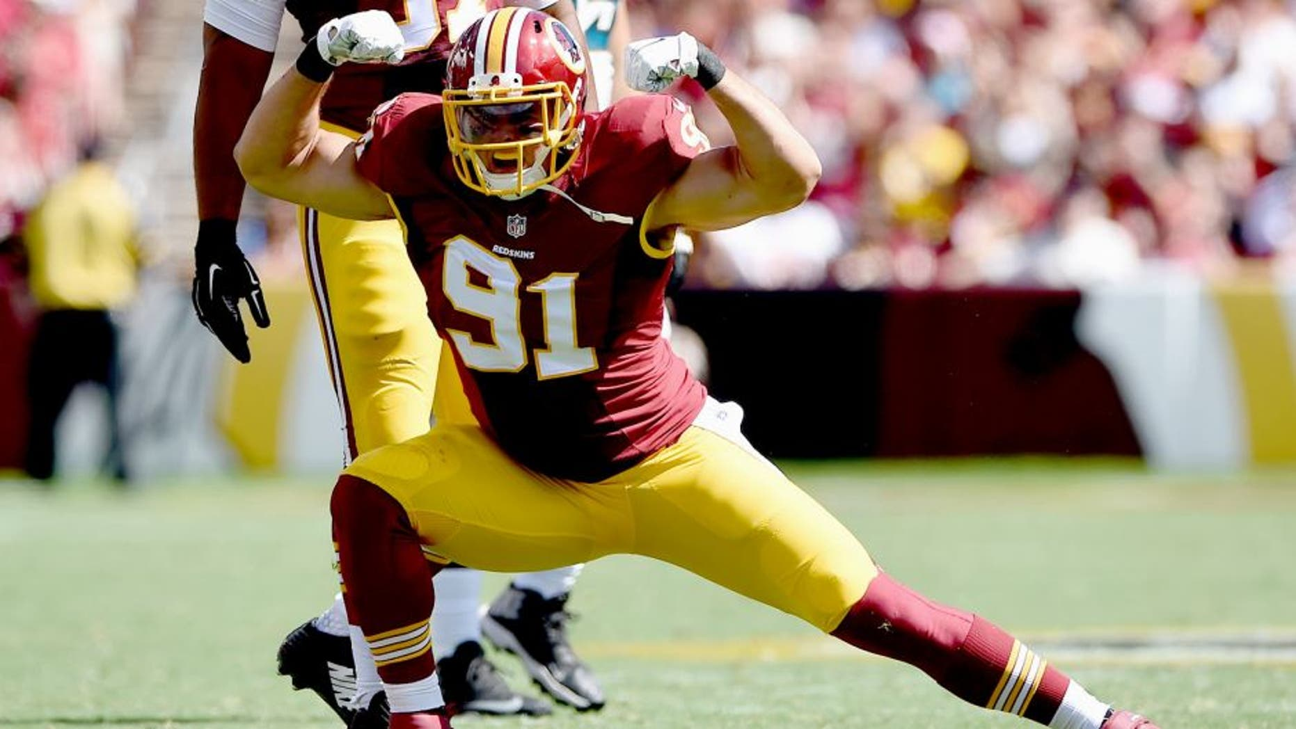 LANDOVER, MD - SEPTEMBER 14: Outside linebacker Ryan Kerrigan #91 of the Washington Redskins celebreates after recording a second quarter sack during a game against the Jacksonville Jaguars at FedExField on September 14, 2014 in Landover, Maryland. (Photo by Patrick Smith/Getty Images)