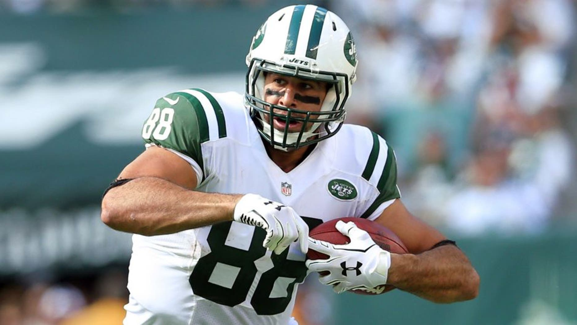Sep 7, 2014; East Rutherford, NJ, USA; New York Jets tight end Jace Amaro (88) runs with the ball against the Oakland Raiders during a game at MetLife Stadium. The Jets defeated the Raiders 19-14. Mandatory Credit: Brad Penner-USA TODAY Sports