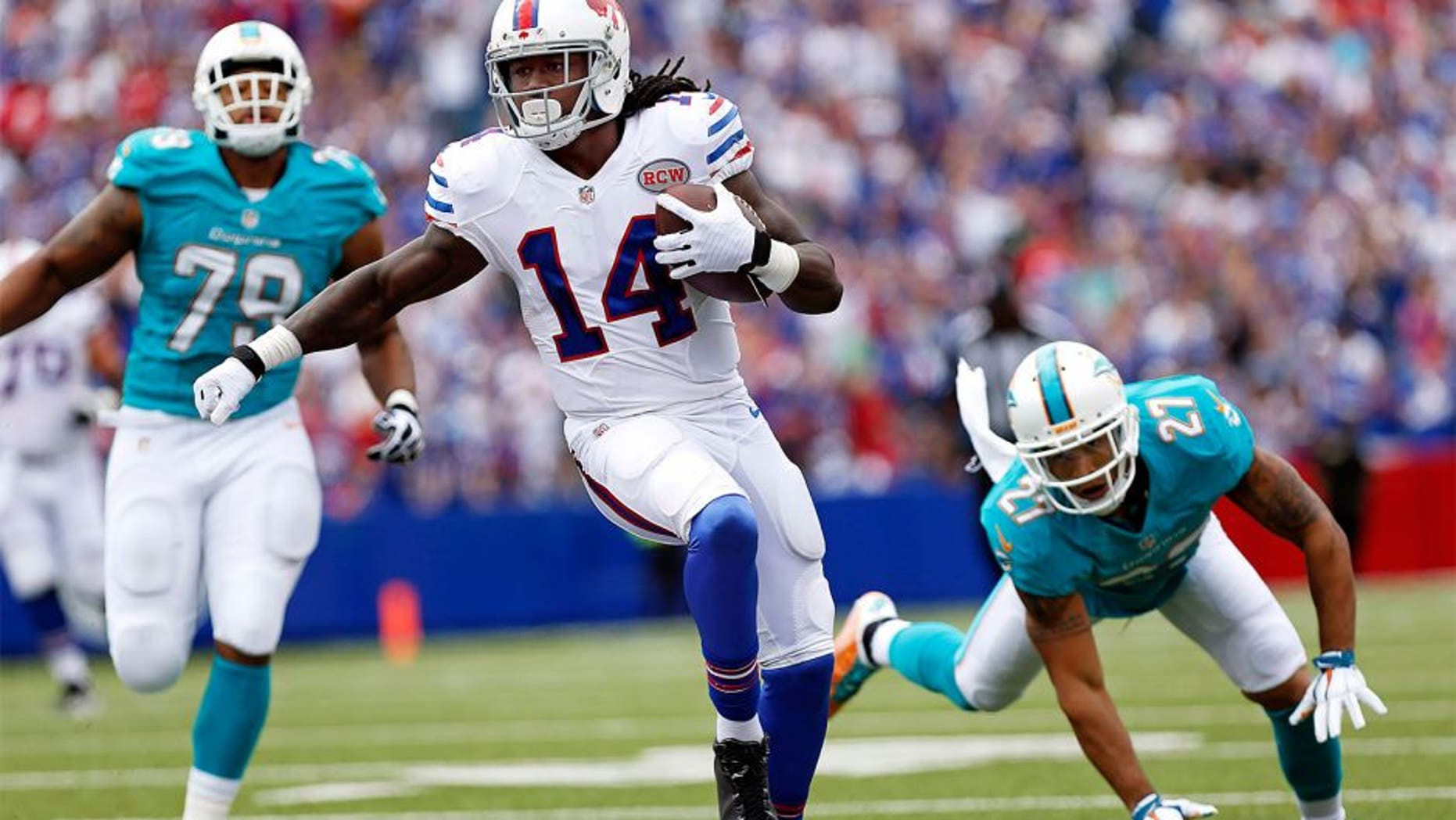 Sep 14, 2014; Orchard Park, NY, USA; Buffalo Bills wide receiver Sammy Watkins (14) runs after a catch as Miami Dolphins strong safety Jimmy Wilson (27) pursues during the first half at Ralph Wilson Stadium. Mandatory Credit: Kevin Hoffman-USA TODAY Sports