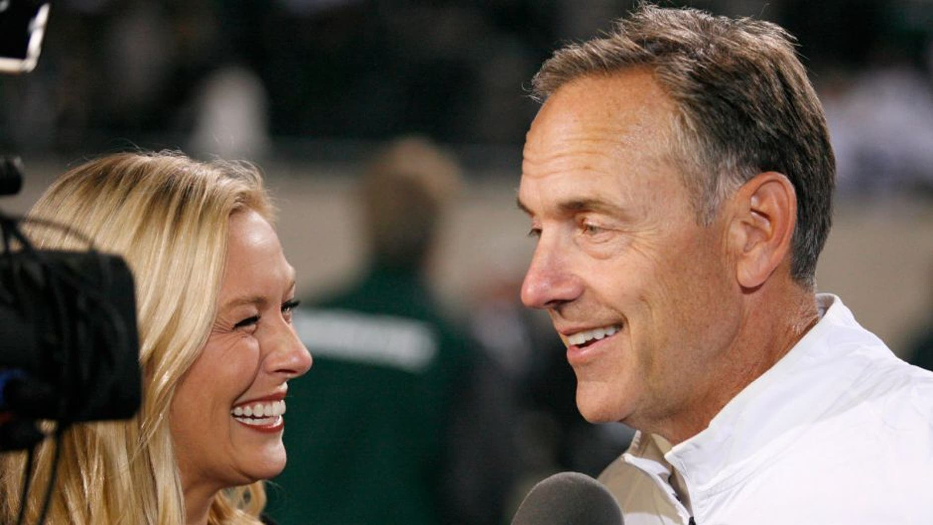 Sep 12, 2015; East Lansing, MI, USA; Michigan State Spartans head coach Mark Dantonio smiles during an interview after the game against the Oregon Ducks at Spartan Stadium. Spartans beat the Ducks 31-28. Mandatory Credit: Raj Mehta-USA TODAY Sports