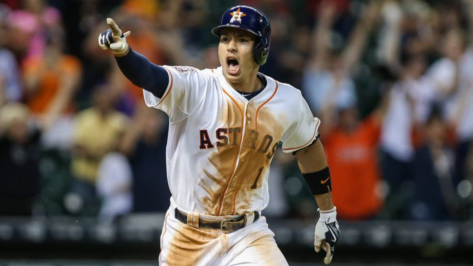 Aug 19, 2015; Houston, TX, USA; Houston Astros shortstop Carlos Correa (1) gets a walk off game-winning RBI single during the thirteenth inning as the Astros defeated the Tampa Bay Rays 3-2 at Minute Maid Park. Mandatory Credit: Troy Taormina-USA TODAY Sports