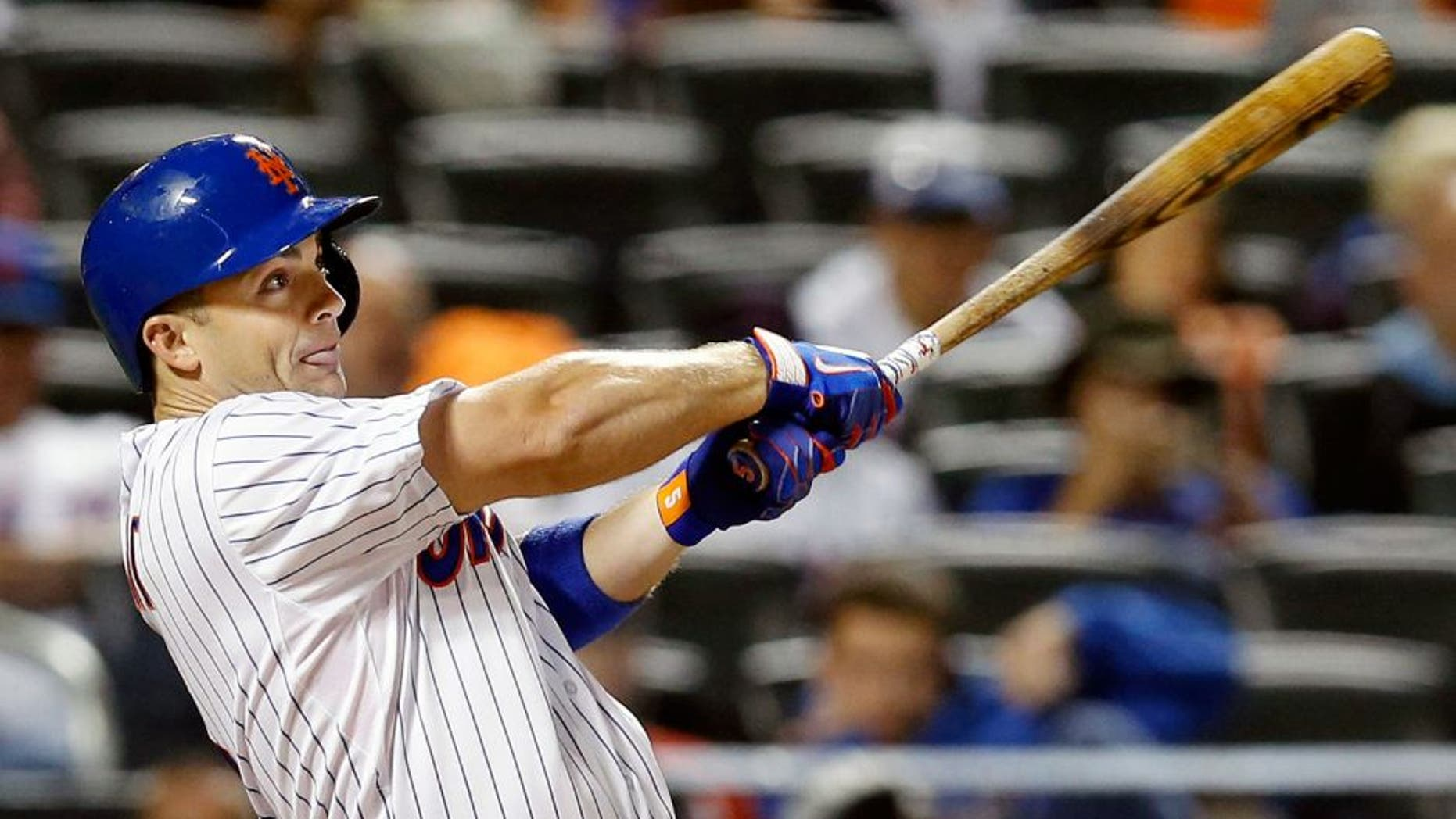 New York Mets' David Wright hits a seventh-inning, RBI, ground-rule double in a baseball game against the Miami Marlins in New York, Monday, Sept. 14, 2015. (AP Photo/Kathy Willens)