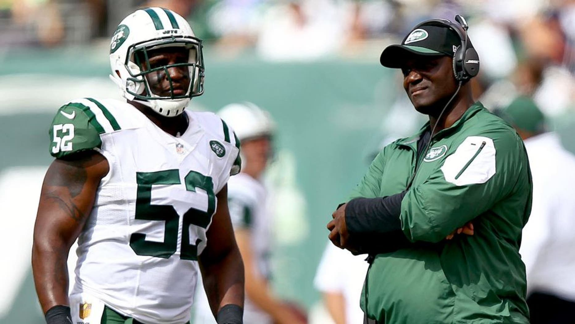 Sep 13, 2015; East Rutherford, NJ, USA; New York Jets head coach Todd Bowles talks to New York Jets linebacker David Harris (52) during the first half at MetLife Stadium. Mandatory Credit: Danny Wild-USA TODAY Sports