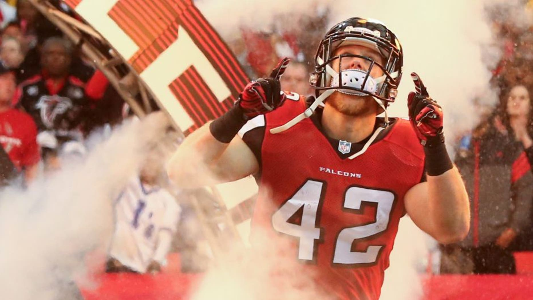 Dec 14, 2014; Atlanta, GA, USA; Atlanta Falcons fullback Patrick DiMarco (42) is introduced before their game against the Pittsburgh Steelers at the Georgia Dome. The Steelers won 27-20. Mandatory Credit: Jason Getz-USA TODAY Sports