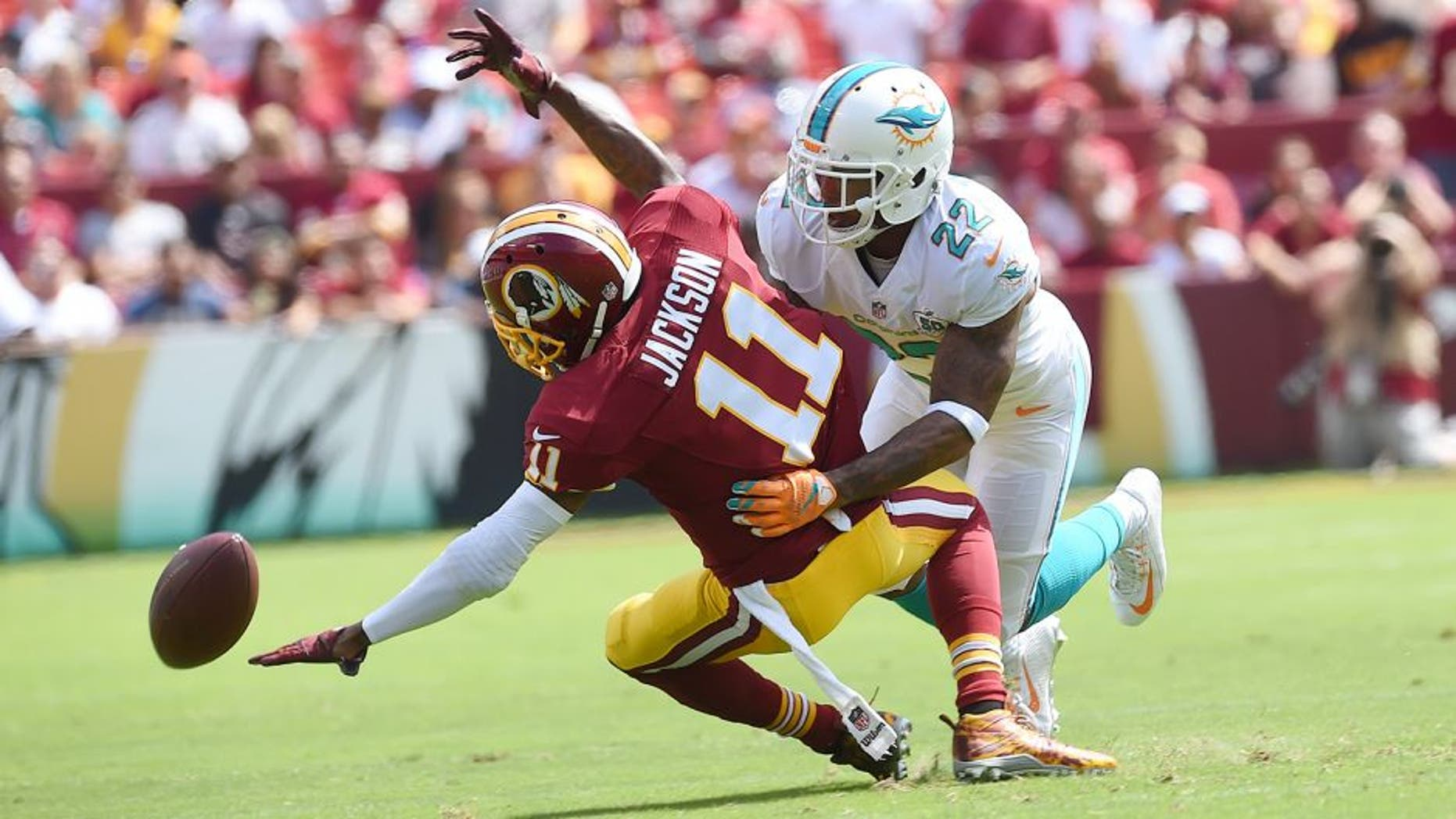 LANDOVER, MD - SEPTEMBER 13: Miami Dolphins cornerback Jamar Taylor (22) is called for pass interference as he defends Washington Redskins wide receiver DeSean Jackson (11) in the first quarter during the game between the Washington Redskins and the Miami Dolphins at FedEx Field on Sunday, September 13, 2015. (Photo by Toni L. Sandys/ The Washington Post via Getty Images)