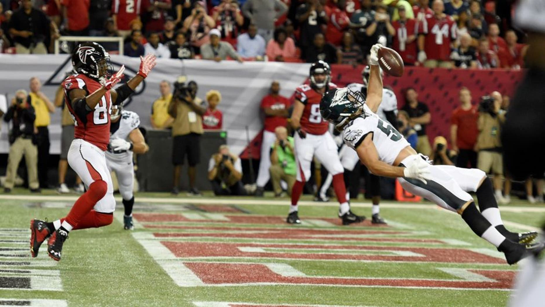 Sep 14, 2015; Atlanta, GA, USA; Philadelphia Eagles linebacker Kiko Alonso (50) intercepts a pass intended for Atlanta Falcons wide receiver Roddy White (84) in the first quarter at the Georgia Dome. Mandatory Credit: Dale Zanine-USA TODAY Sports