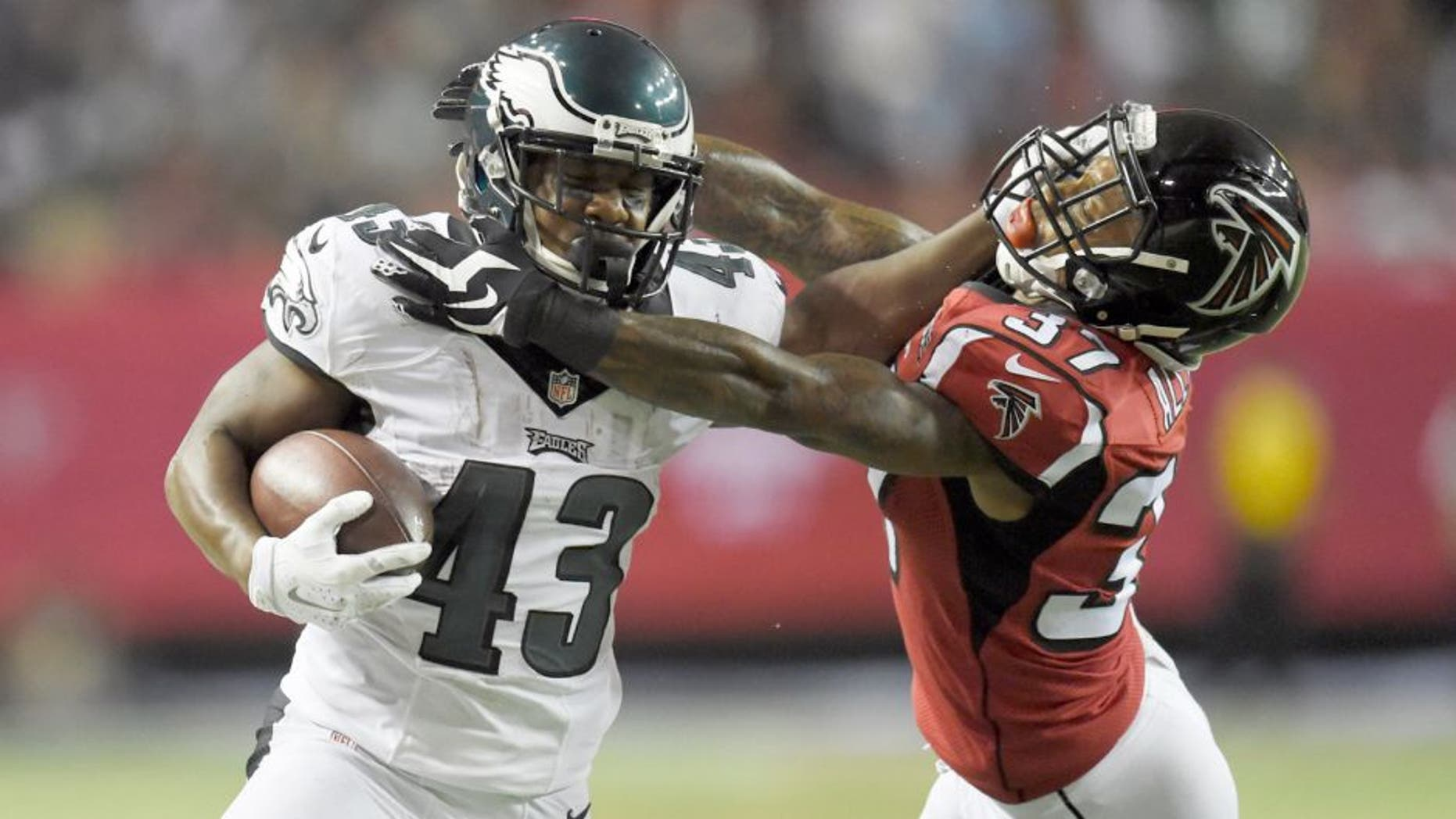 Sep 14, 2015; Atlanta, GA, USA; Philadelphia Eagles running back Darren Sproles (43) is tackled by Atlanta Falcons cornerback Ricardo Allen (37) in the third quarter at the Georgia Dome. Mandatory Credit: Dale Zanine-USA TODAY Sports
