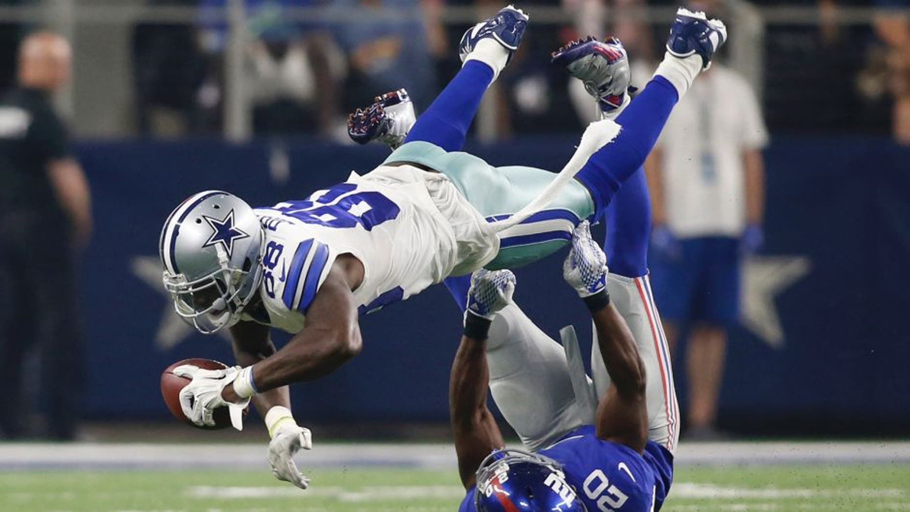 Sep 13, 2015; Arlington, TX, USA; Dallas Cowboys wide receiver Dez Bryant (88) catches the ball as New York Giants cornerback Prince Amukamara (20) tackles at AT&T Stadium. The Cowboys won 27-26. Mandatory Credit: Tim Heitman-USA TODAY Sports