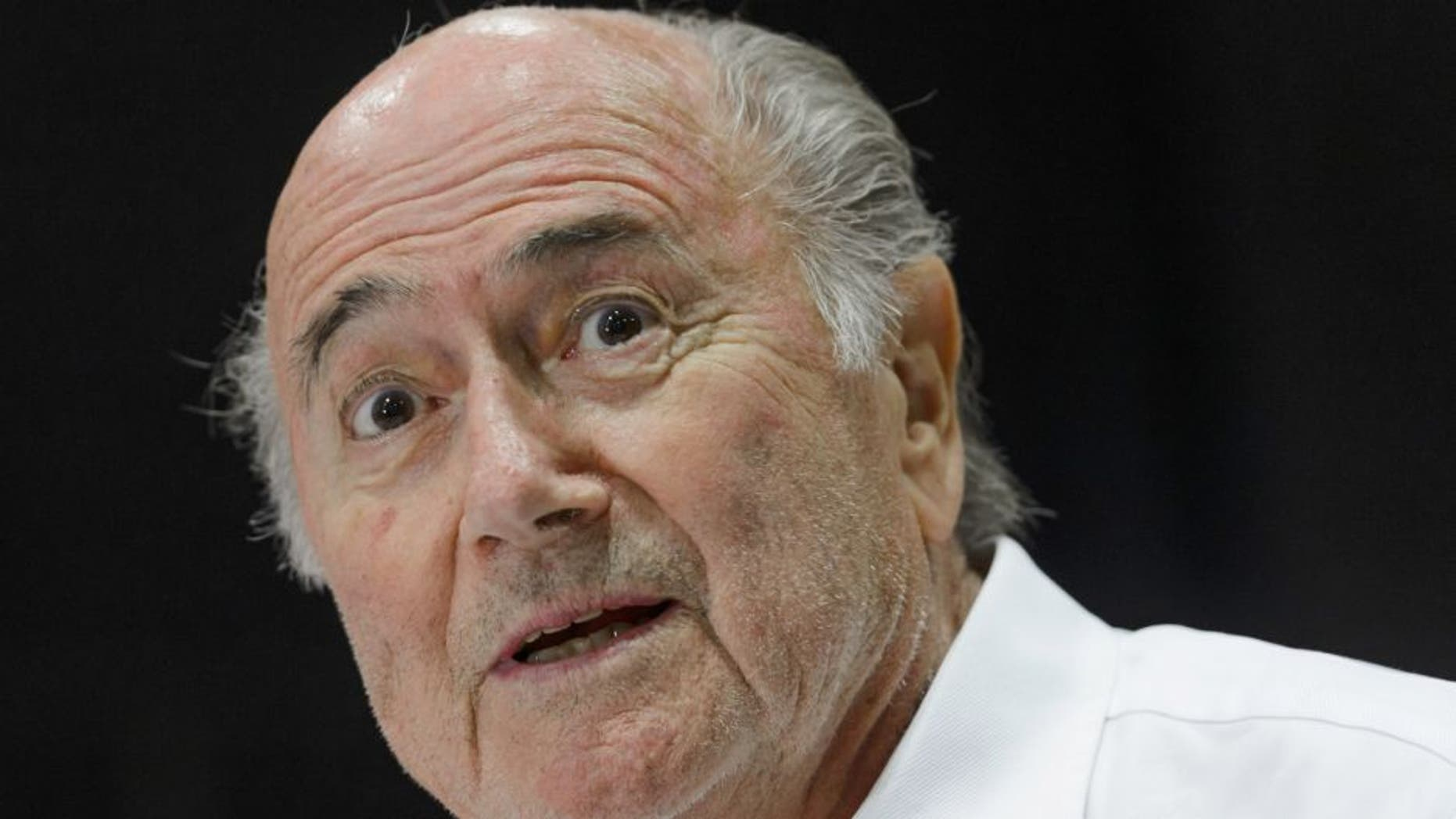 """Outgoing FIFA president Sepp Blatter answers to a press conference during the """"Sepp Blatter Tournament"""" on August 22, 2015 in Ulrichen, Blatter's hometown. When Blatter was elected FIFA President in 1998, the town awarded him with the """"honorary burgher"""" of Ulrichen title and to commemorate the occasion, a football tournament bearing his name was created. AFP PHOTO / FABRICE COFFRINI (Photo credit should read FABRICE COFFRINI/AFP/Getty Images)"""