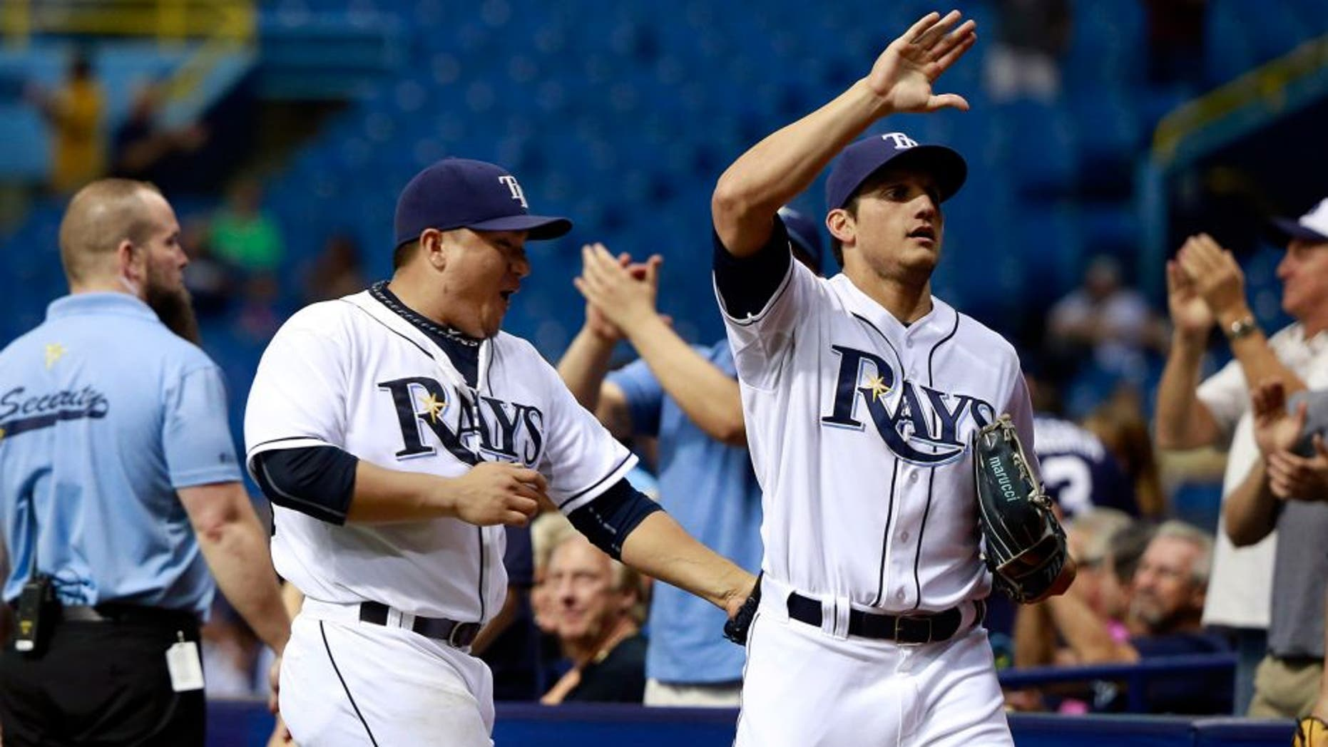 Sep 14, 2015; St. Petersburg, FL, USA; Tampa Bay Rays starting pitcher Erasmo Ramirez (30) high fives Tampa Bay Rays right fielder Mikie Mahtook (27) as he got an unassisted double play to end the seventh inning against the New York Yankees at Tropicana Field. Mandatory Credit: Kim Klement-USA TODAY Sports