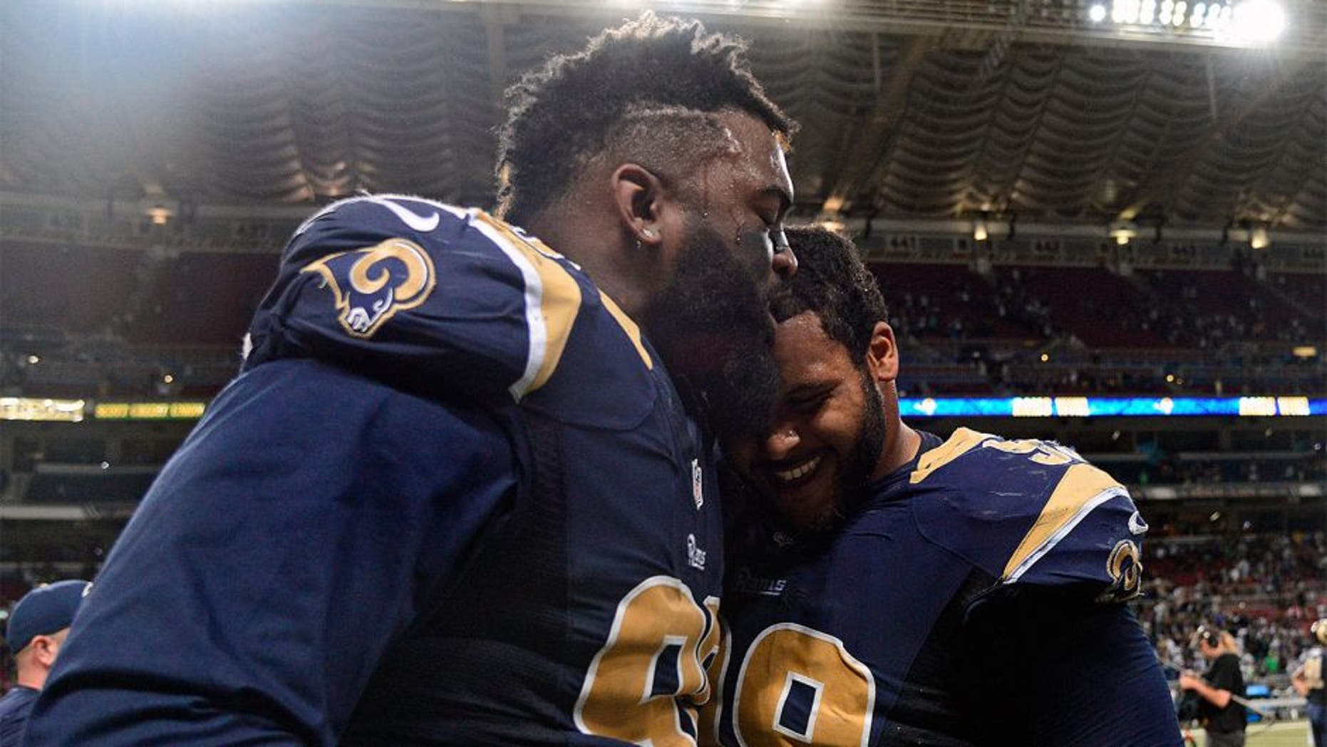 Sep 13, 2015; St. Louis, MO, USA; St. Louis Rams defensive tackle Michael Brockers (90) celebrates with defensive tackle Aaron Donald (99) after defeating the Seattle Seahawks 34-31 in overtime at the Edward Jones Dome. Mandatory Credit: Jeff Curry-USA TODAY Sports