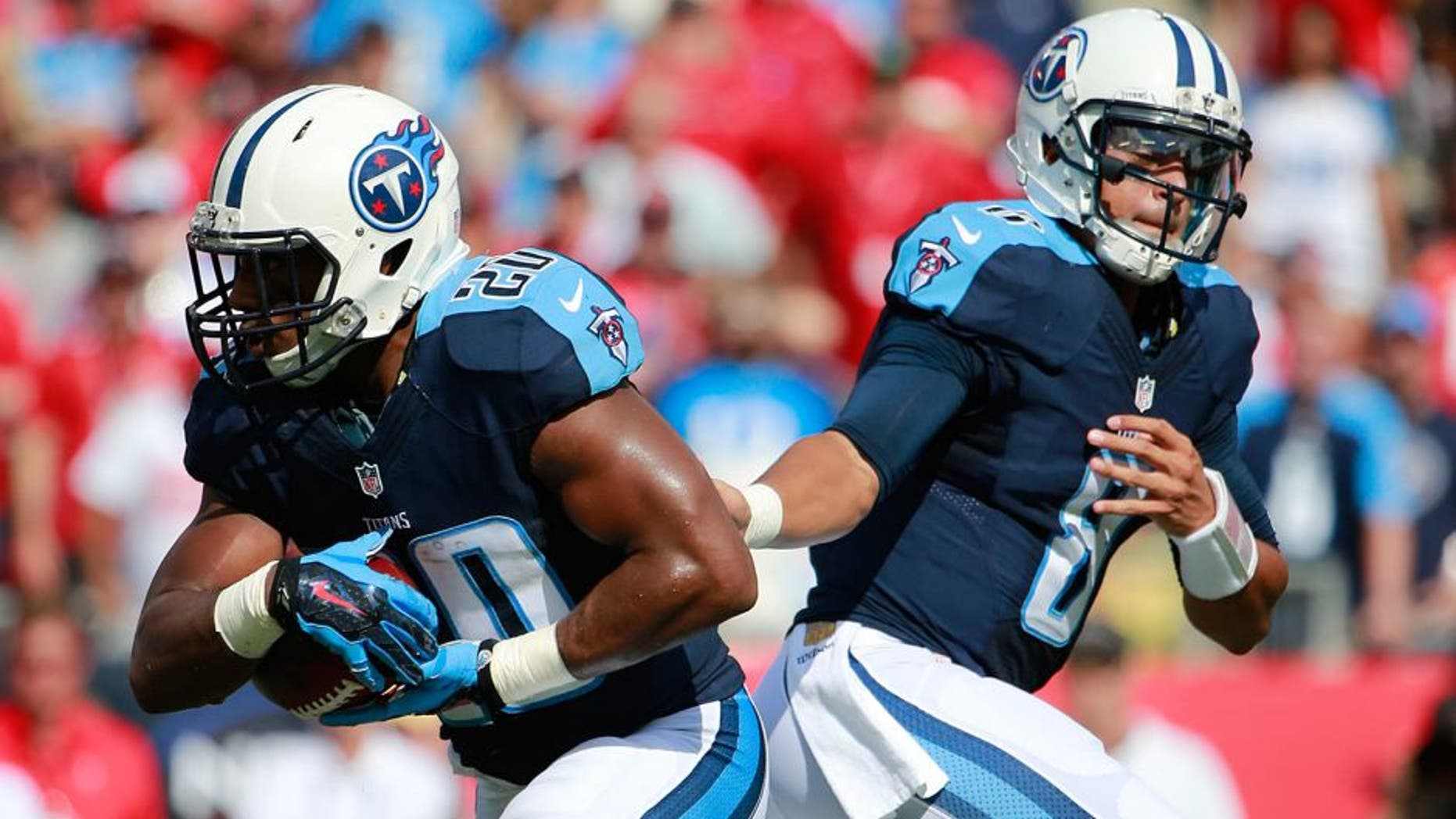 Sep 13, 2015; Tampa, FL, USA; Tennessee Titans quarterback Marcus Mariota (8) hands the ball off to running back Bishop Sankey (20) during the first quarter against the Tampa Bay Buccaneers at Raymond James Stadium. Mandatory Credit: Kim Klement-USA TODAY Sports