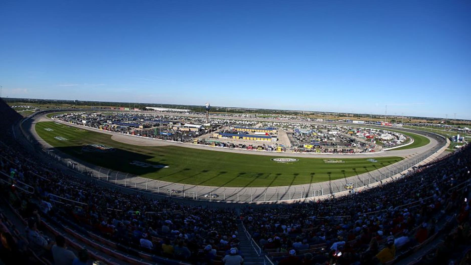 Race fans cheer during the NASCAR Sprint Cup Series myAFibRisk.com 400 at Chicagoland Speedway on September 20, 2015 in Joliet, Illinois.