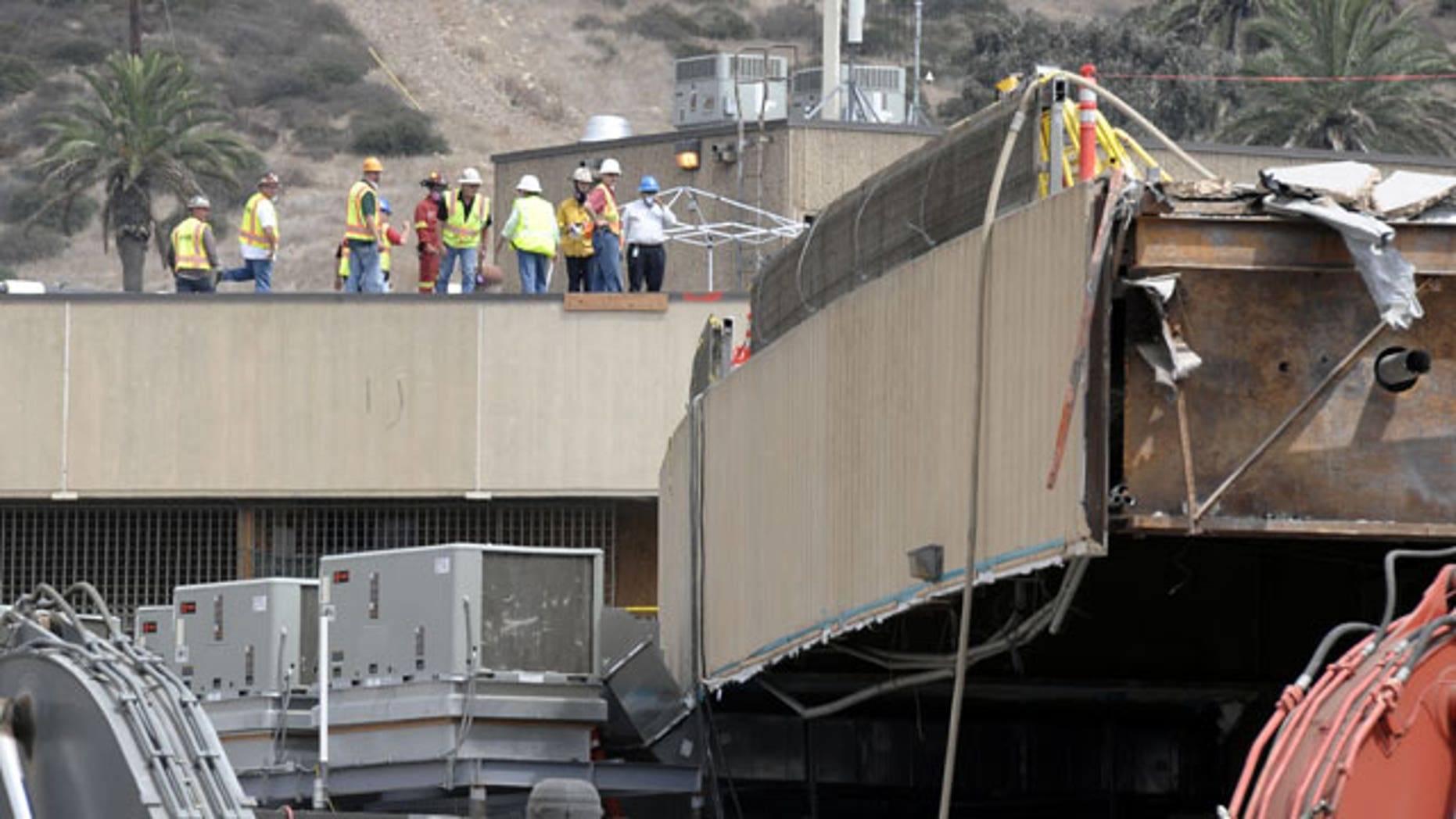 September 14: Border officials and emergency personnel look over the construction site where scaffolding collapsed at the San Ysidro Port of Entry in San Diego.