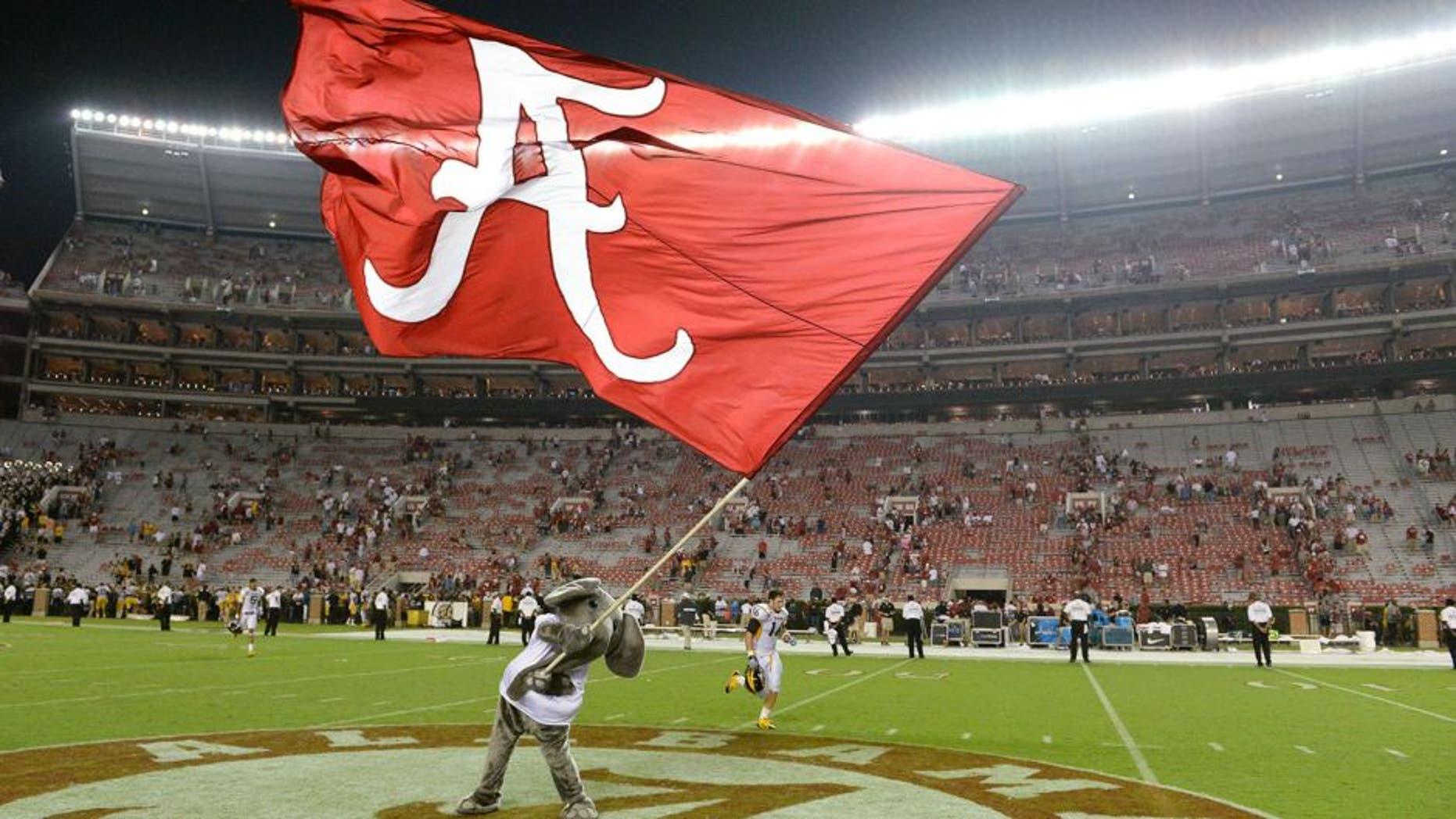 Sep 13, 2014; Tuscaloosa, AL, USA; Alabama Crimson Tide mascot Big Al waves the Alabama flag following their 52-12 victory against the Southern Miss Golden Eagles at Bryant-Denny Stadium. Mandatory Credit: John David Mercer-USA TODAY Sports