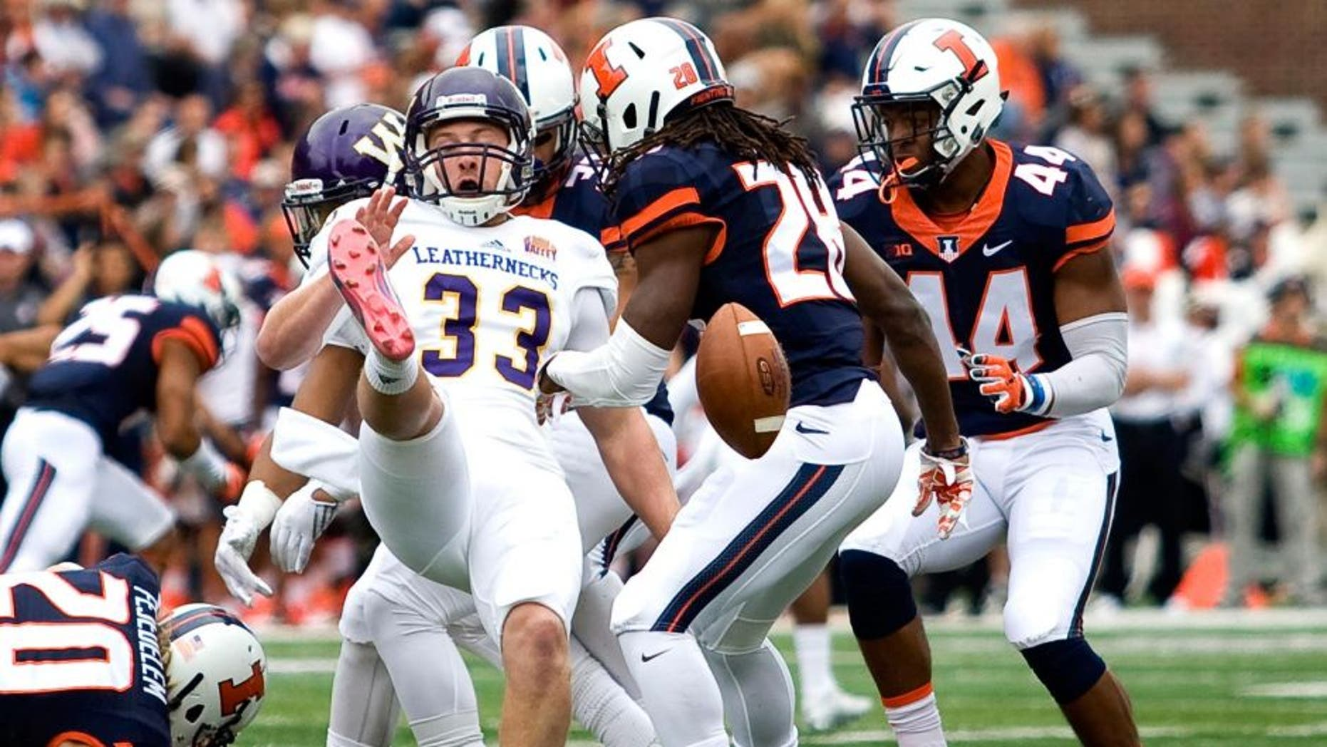 Sep 12, 2015; Champaign, IL, USA; Illinois Fighting Illini defensive back Jaylen Dunlap (28) blocks the punt from Western Illinois Leathernecks place kicker Nathan Knuffman (33) which was run back for a touchdown by Illinois Fighting Illini wide receiver Marchie Murdock (not pictured) at Memorial Stadium. Mandatory Credit: Mike Granse-USA TODAY Sports