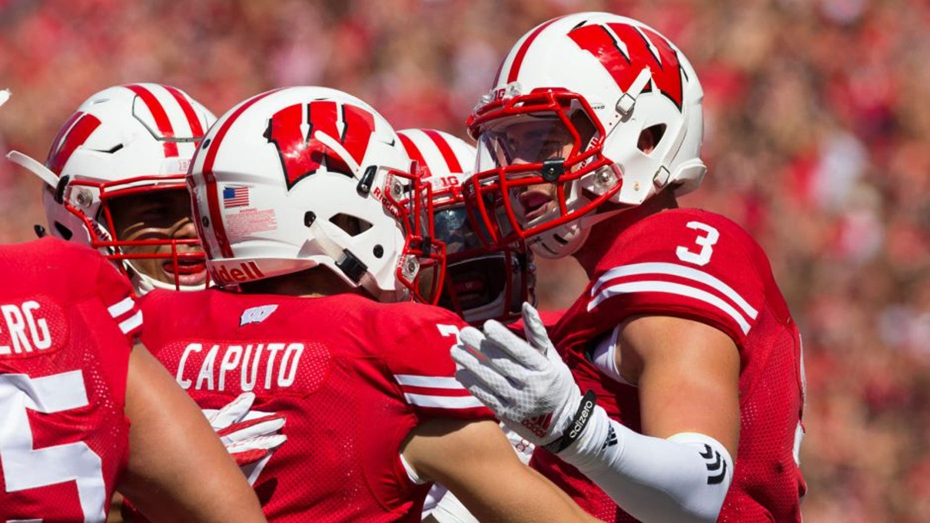 Sep 12, 2015; Madison, WI, USA; Wisconsin Badgers safety Tanner McEvoy (3) celebrates following an interception during the second quarter against the Miami (Ohio) RedHawks at Camp Randall Stadium. Mandatory Credit: Jeff Hanisch-USA TODAY Sports