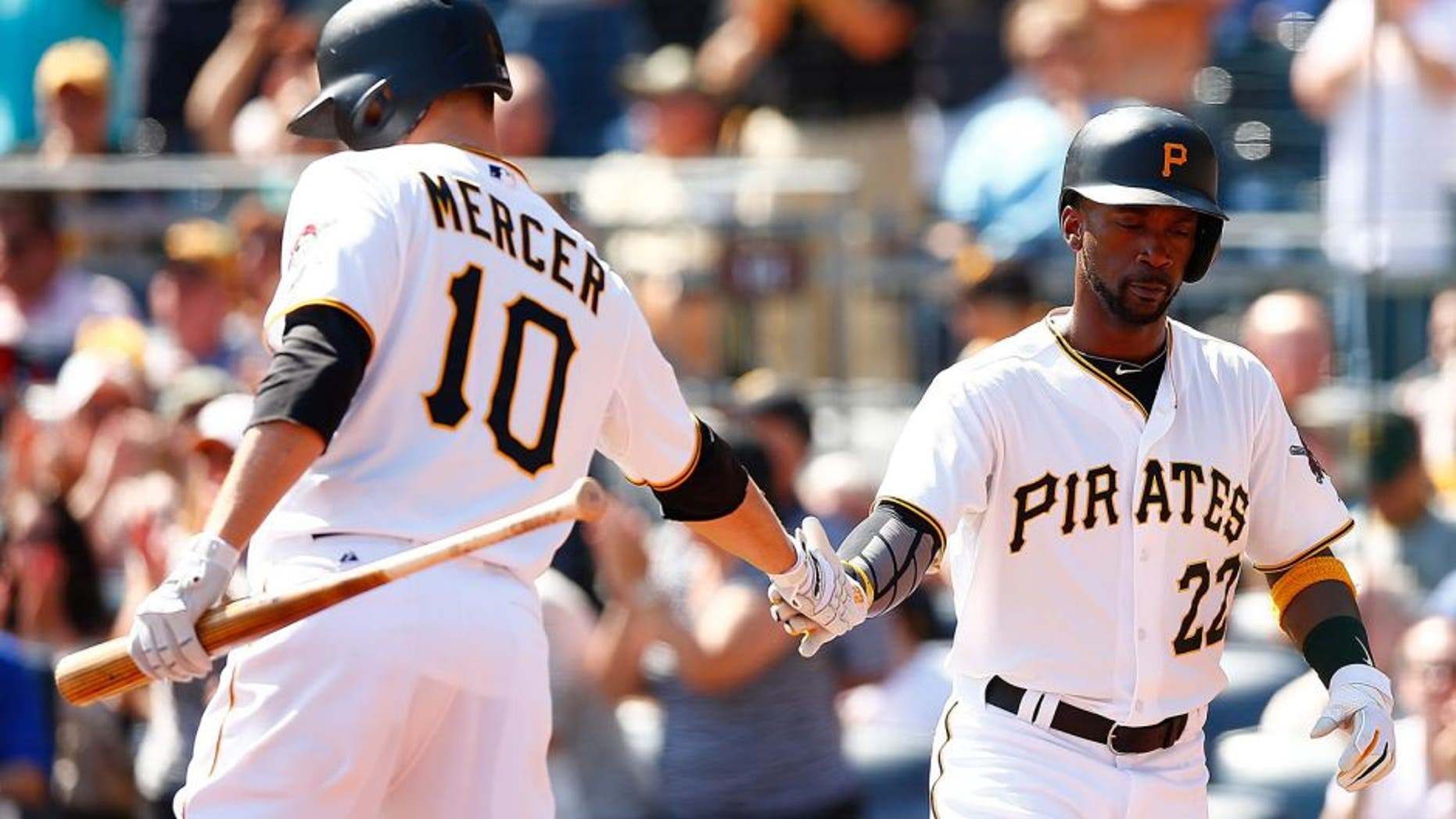 PITTSBURGH, PA - SEPTEMBER 15: Andrew McCutchen #22 of the Pittsburgh Pirates is congratulated by teammate Jordy Mercer #10 after scoring in the first inning against the Chicago Cubs during game one of the doubleheader at PNC Park on September 15, 2015 in Pittsburgh, Pennsylvania. (Photo by Jared Wickerham/Getty Images)