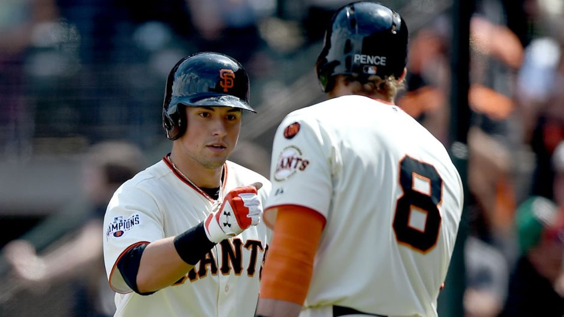 SAN FRANCISCO, CA - MAY 31: Joe Panik #12 of the San Francisco Giants is congratulated by Hunter Pence #8 after Panik hit a two-run homer against the Atlanta Braves in the bottom of the seventh inning at AT&T Park on May 31, 2015 in San Francisco, California. (Photo by Thearon W. Henderson/Getty Images)