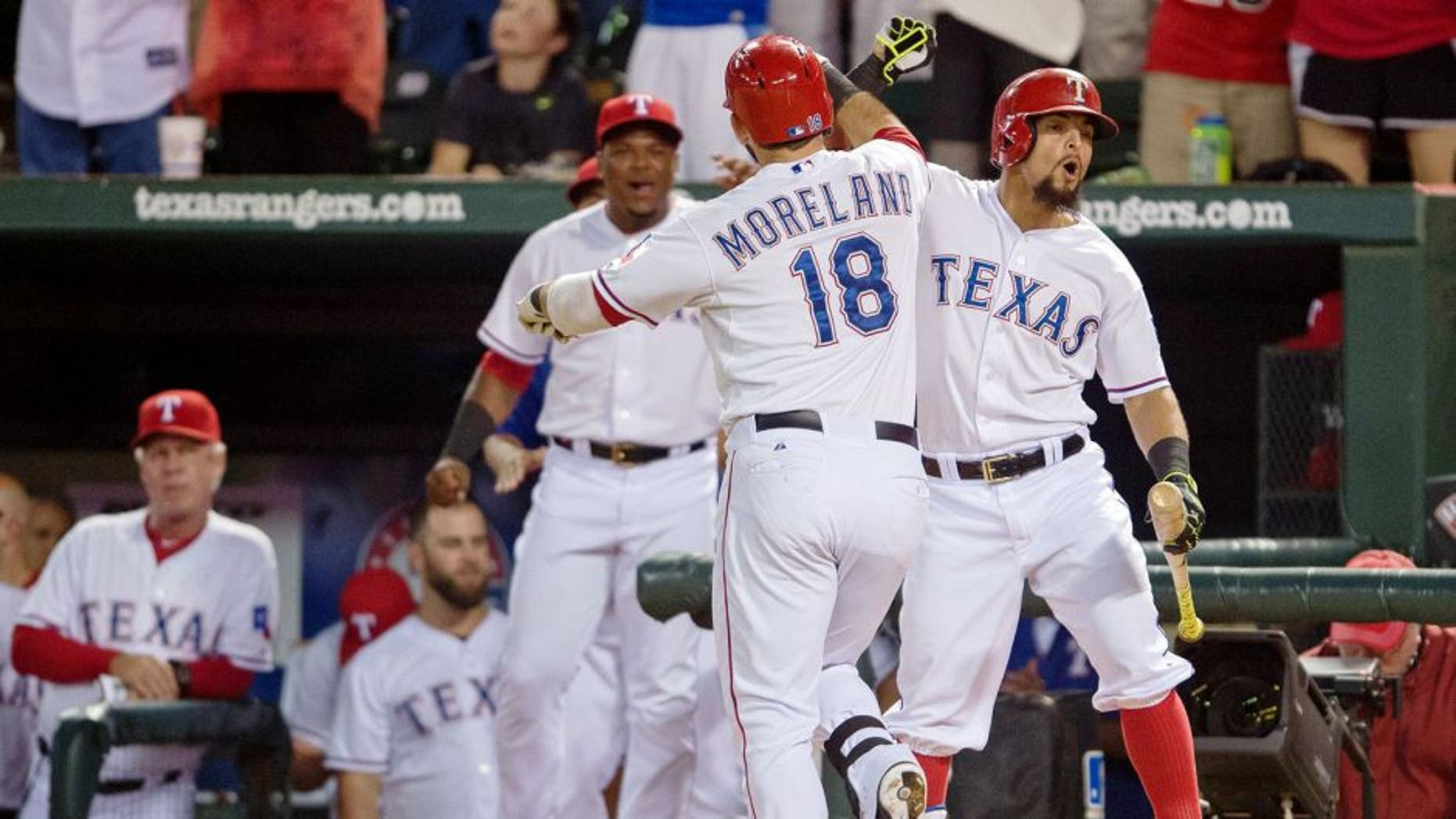 Sep 14, 2015; Arlington, TX, USA; Texas Rangers second baseman Rougned Odor (right) congratulates first baseman Mitch Moreland (18) for hitting a two run home run during the sixth inning against the Houston Astros at Globe Life Park in Arlington. Mandatory Credit: Jerome Miron-USA TODAY Sports