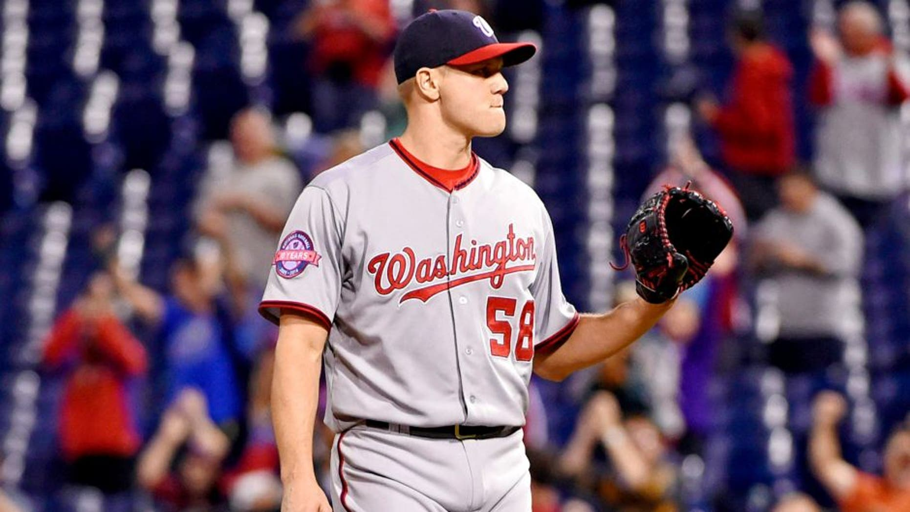 Sep 14, 2015; Philadelphia, PA, USA; Washington Nationals relief pitcher Jonathan Papelbon (58) waits for a new baseball after allowing a game-tying home run during the tenth inning against the Philadelphia Phillies at Citizens Bank Park. The Nationals defeated the Phillies, 8-7 in 11 innings. Mandatory Credit: Eric Hartline-USA TODAY Sports