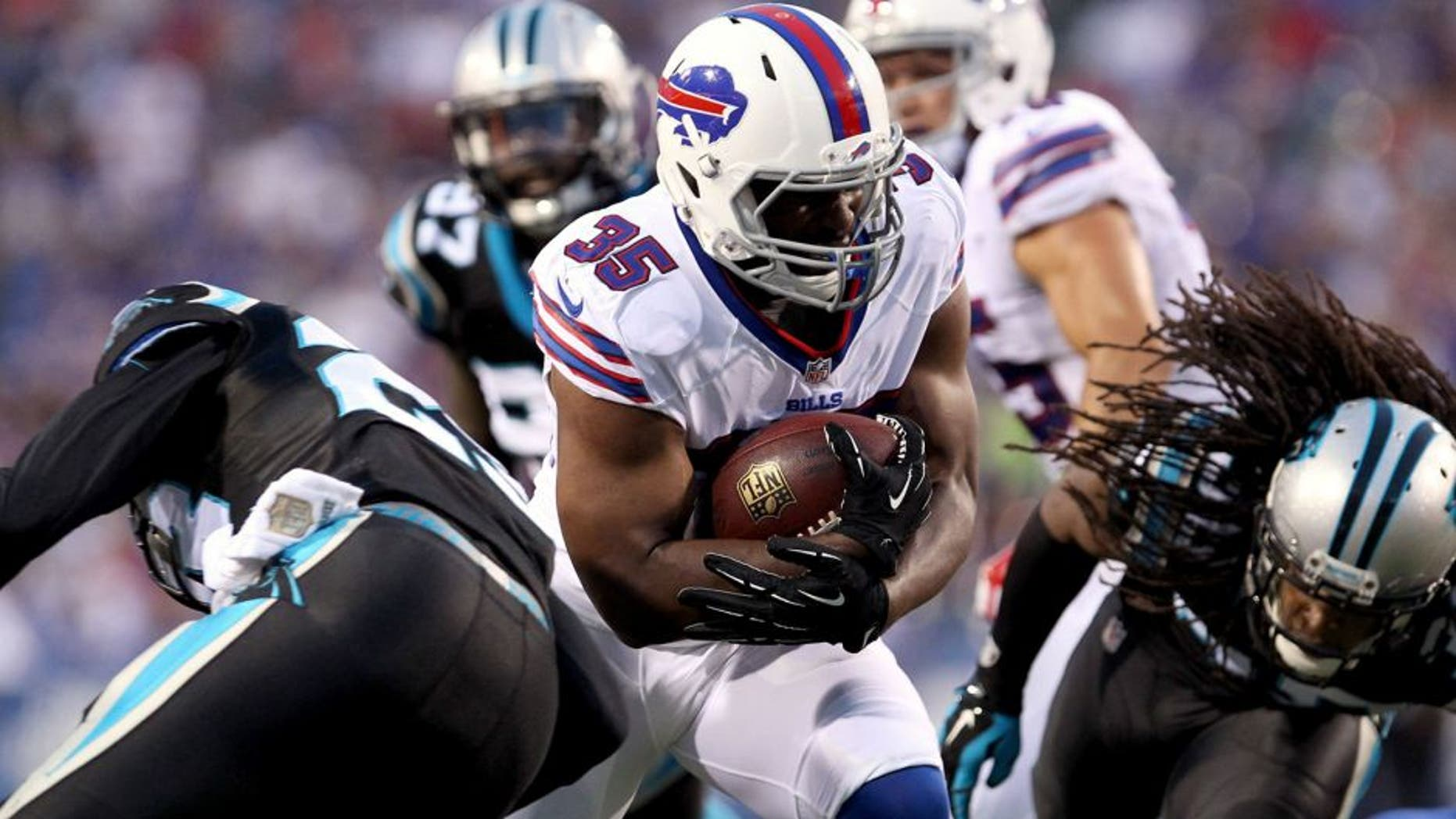 Aug 14, 2015; Orchard Park, NY, USA; Buffalo Bills running back Bryce Brown (35) runs the ball during the first half against the Carolina Panthers in a preseason NFL football game at Ralph Wilson Stadium. Mandatory Credit: Timothy T. Ludwig-USA TODAY Sports