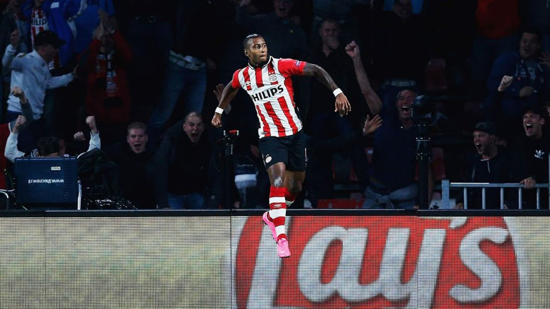 EINDHOVEN, NETHERLANDS - SEPTEMBER 15: Luciano Narsingh of PSV Eindhoven celebrates scoring his team's second goal during the UEFA Champions League Group B match between PSV Eindhoven and Manchester United at PSV Stadion on September 15, 2015 in Eindhoven, Netherlands. (Photo by Dean Mouhtaropoulos/Getty Images)