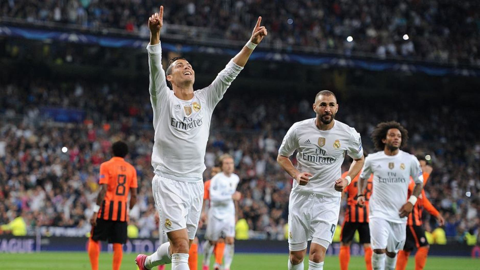 MADRID, SPAIN - SEPTEMBER 15: Cristiano Ronaldo of Real Madrid celebrates after scoring Real's 2nd goal from the penalty spot during the UEFA Champions League Group A match between Real Madrid and Shakhtar Donetsk at estadio Santiago Bernabeu on September 15, 2015 in Madrid, Spain. (Photo by Denis Doyle/Getty Images)
