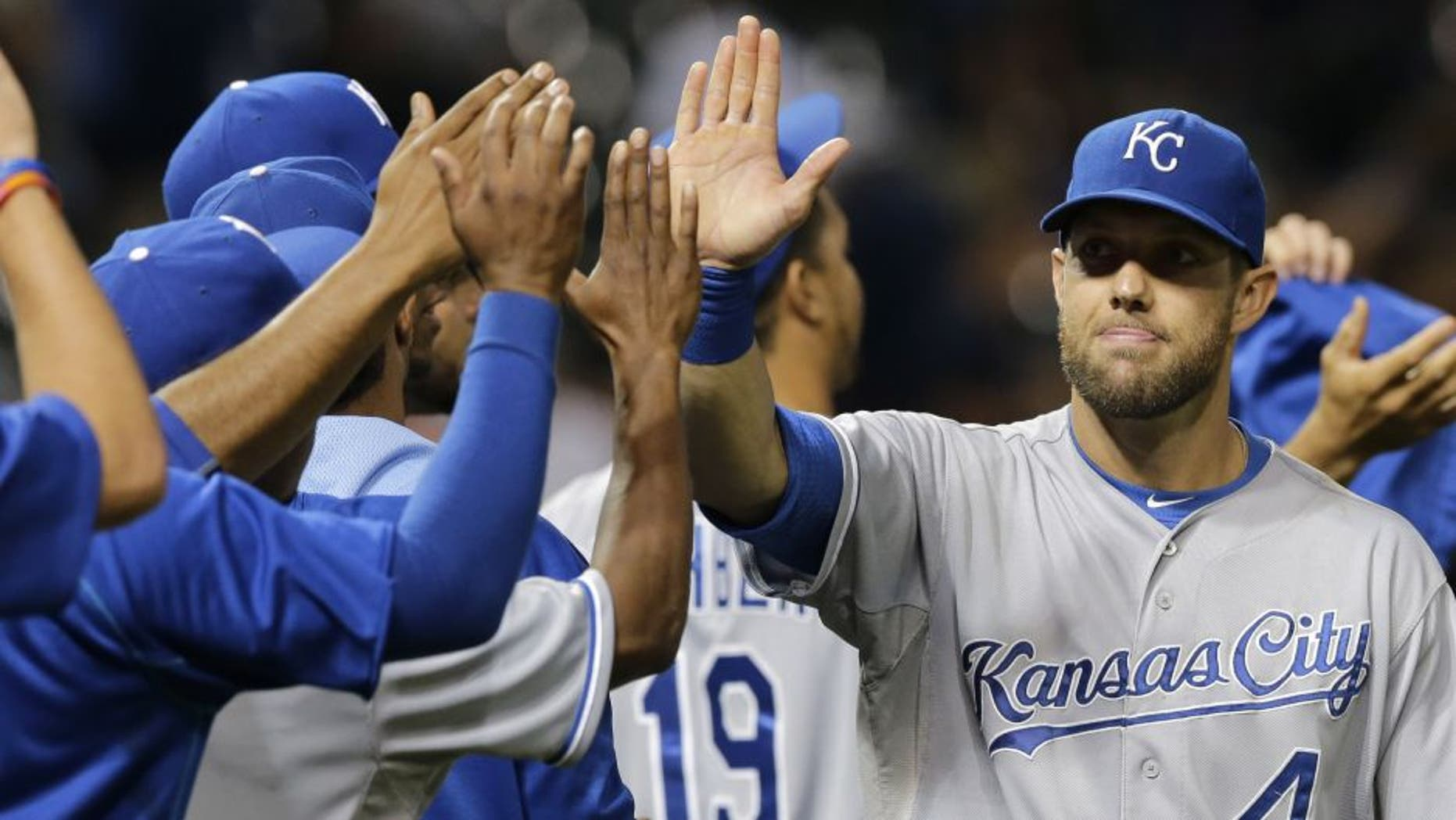 Kansas City Royals' Alex Gordon is congratulated after the Royals defeated the Cleveland Indians 2-0 on Tuesday night