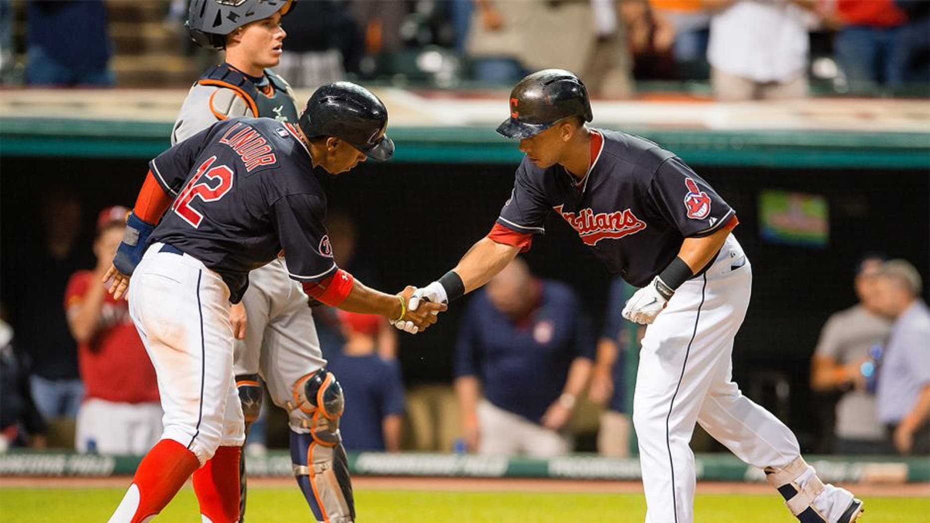CLEVELAND, OH - SEPTEMBER 10: Francisco Lindor #12 of celebrates with Michael Brantley #23 of the Cleveland Indians after Brantley hit a two run home run during the eighth inning against the Detroit Tigers at Progressive Field on September 10, 2015 in Cleveland, Ohio. (Photo by Jason Miller/Getty Images)