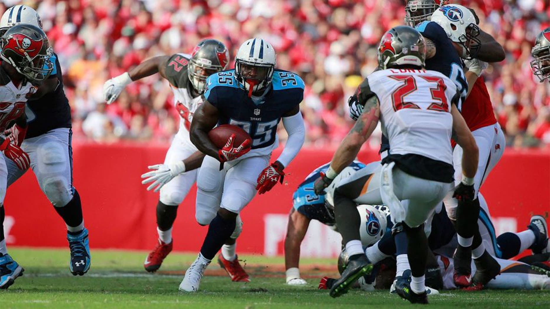 Sep 13, 2015; Tampa, FL, USA; Tennessee Titans running back Terrance West (35) runs with the ball against the Tampa Bay Buccaneers during the first half at Raymond James Stadium. Mandatory Credit: Kim Klement-USA TODAY Sports