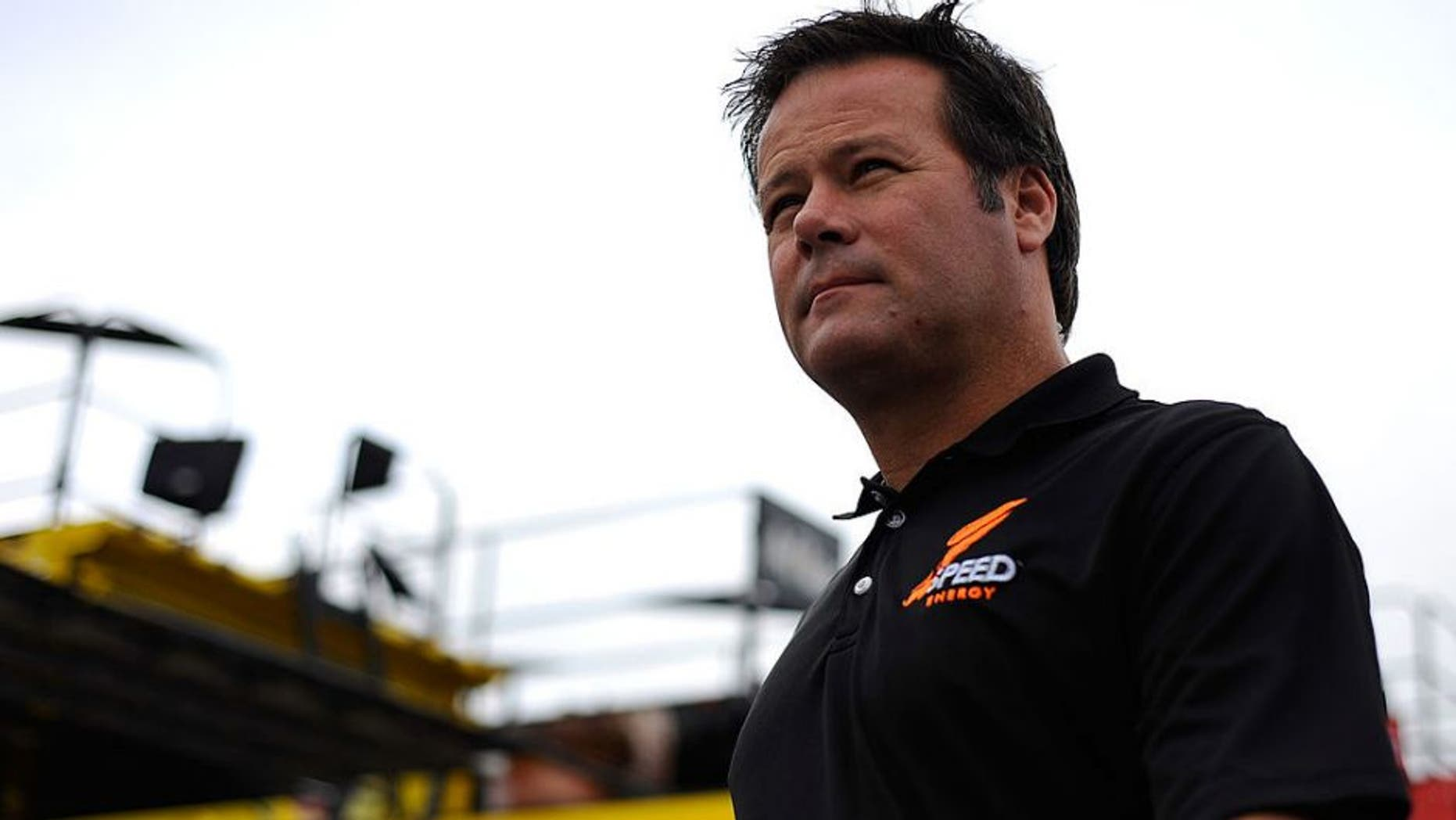 LOUDON, NH - SEPTEMBER 23: Robby Gordon, driver of the #7 Speed Energy Dodge, walks through the garage area during practice for the NASCAR Sprint Cup Series Sylvania 300 at New Hampshire Motor Speedway on September 23, 2011 in Loudon, New Hampshire. (Photo by Jason Smith/Getty Images for NASCAR)