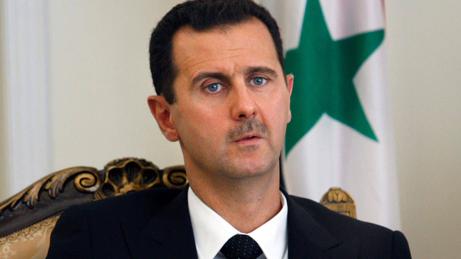 Aug. 19, 2009: This file photo shows Syrian President Bashar Assad during a meeting with his Iranian counterpart Mahmoud Ahmadinejad in Tehran, Iran.