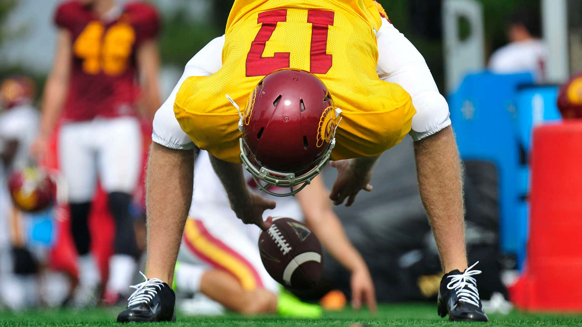 Sept. 15, 2015: This photo provided by the University of Southern California shows USC football player Jake Olson snaping the ball during NCAA college football practice on in Los Angeles.
