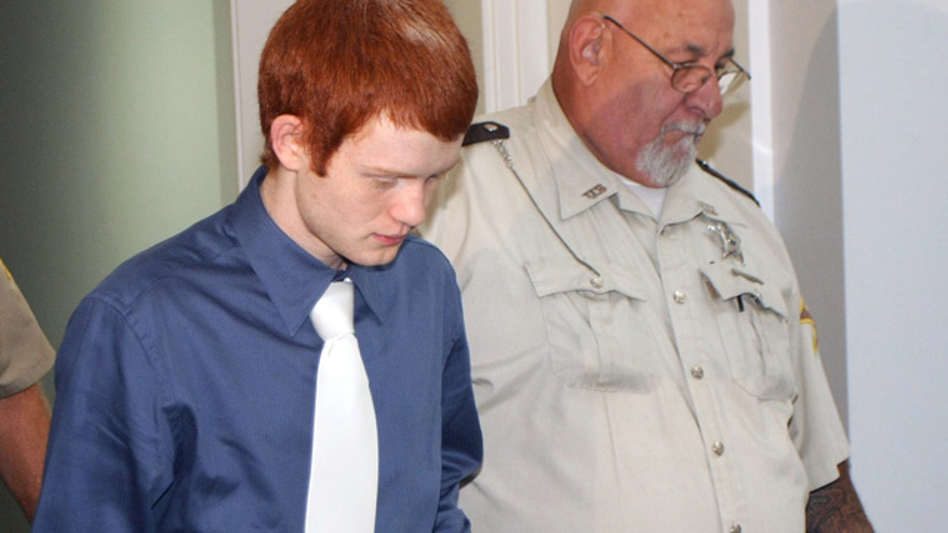 Sept. 15: Andrew Conley, left, is led into an Ohio County courtroom for his sentencing hearing in Rising Sun, Ind.