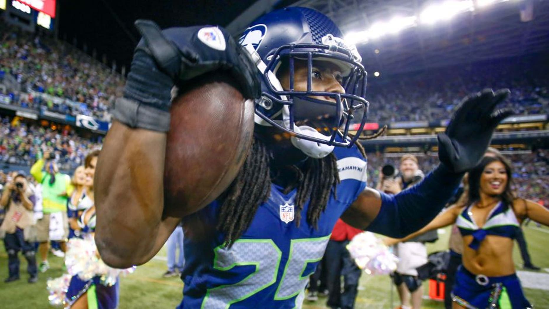 SEATTLE, WA - SEPTEMBER 15: Cornerback Richard Sherman #25 of the Seattle Seahawks celebrates after making an interception in the second half against the San Francisco 49ers at CenturyLink Field on September 15, 2013 in Seattle, Washington. (Photo by Otto Greule Jr/Getty Images)