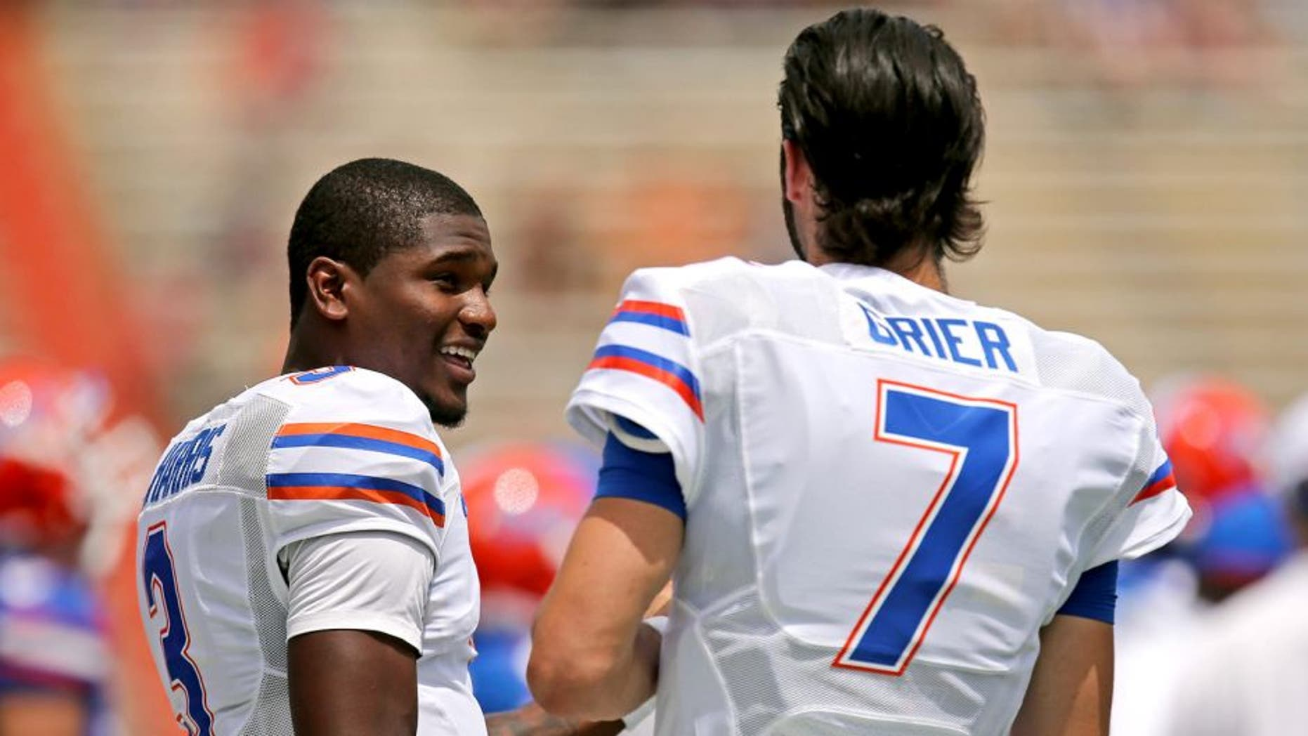 GAINESVILLE, FL - APRIL 11: Florida Gators quarterbacks Treon Harris #3 and Will Grier #7 talk on the sidelines during the Orange and Blue Debut spring football game on April 11, 2015 in Gainesville, Florida. (Photo by Rob Foldy/Getty Images)