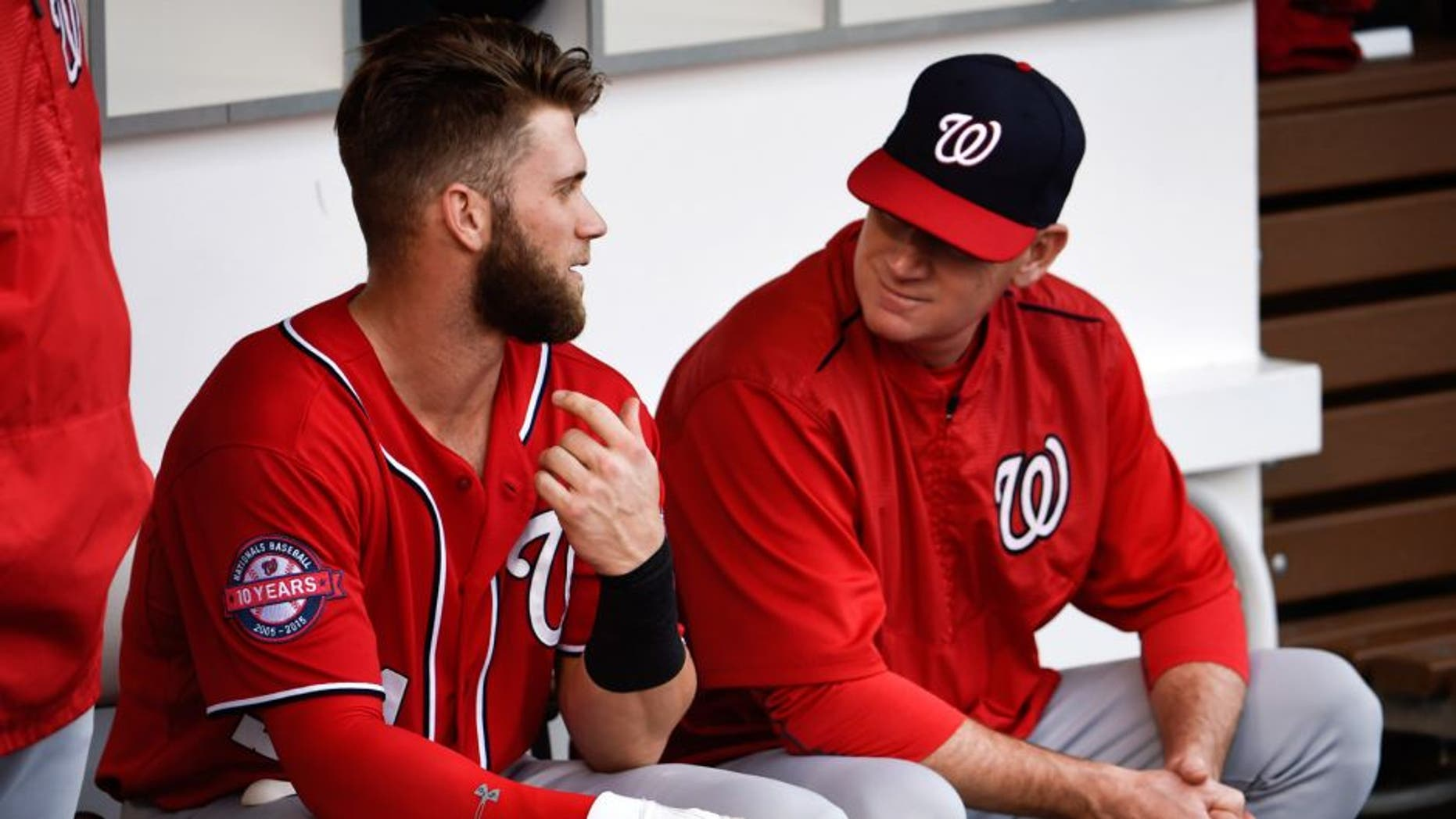 SAN DIEGO, CA - MAY 16: Bryce Harper #34 of the Washington Nationals, left, talks with Matt Williams #9 before a baseball game against the San Diego Padres at Petco Park May 16, 2015 in San Diego, California. (Photo by Denis Poroy/Getty Images)